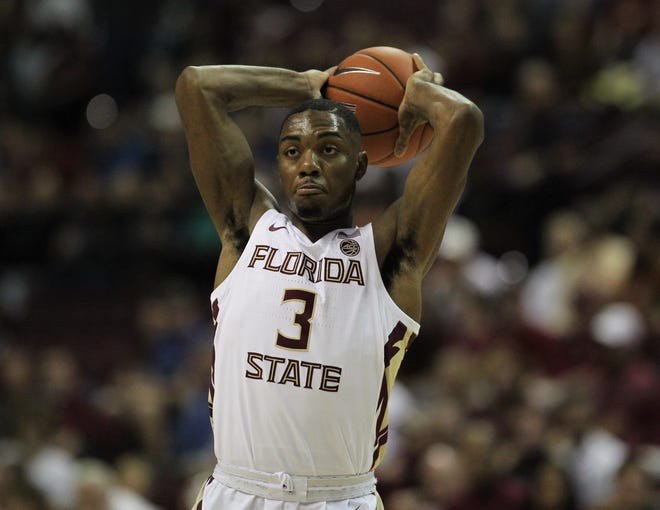 Florida State's Trent Forrest makes a skip pass during the Sunshine Showdown game against Florida on Tuesday at the Tucker Civic Center.