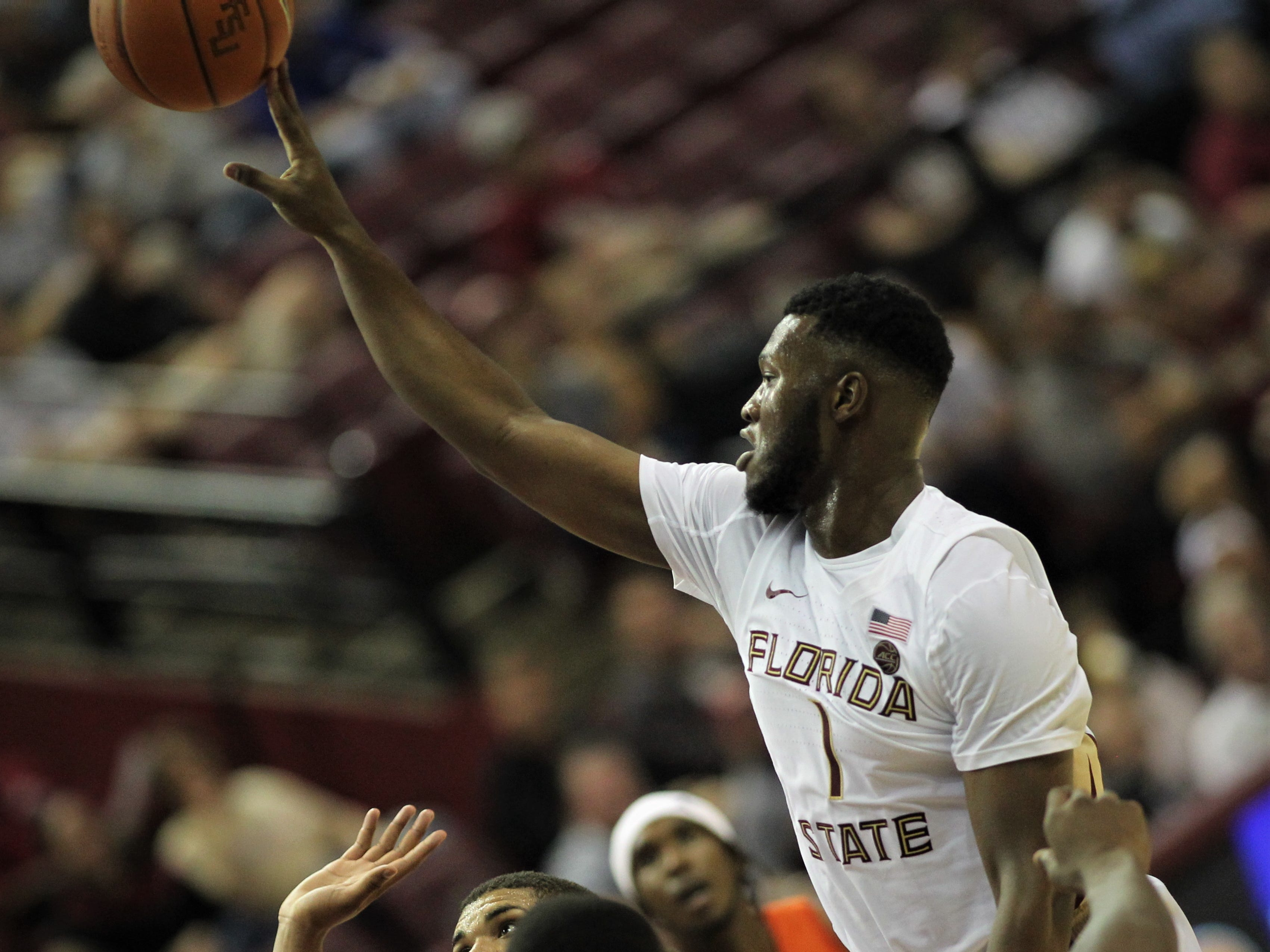 Florida State's Raiquan Gray goes up for a shot against Florida during the Sunshine Showdown game Tuesday at the Tucker Civic Center.