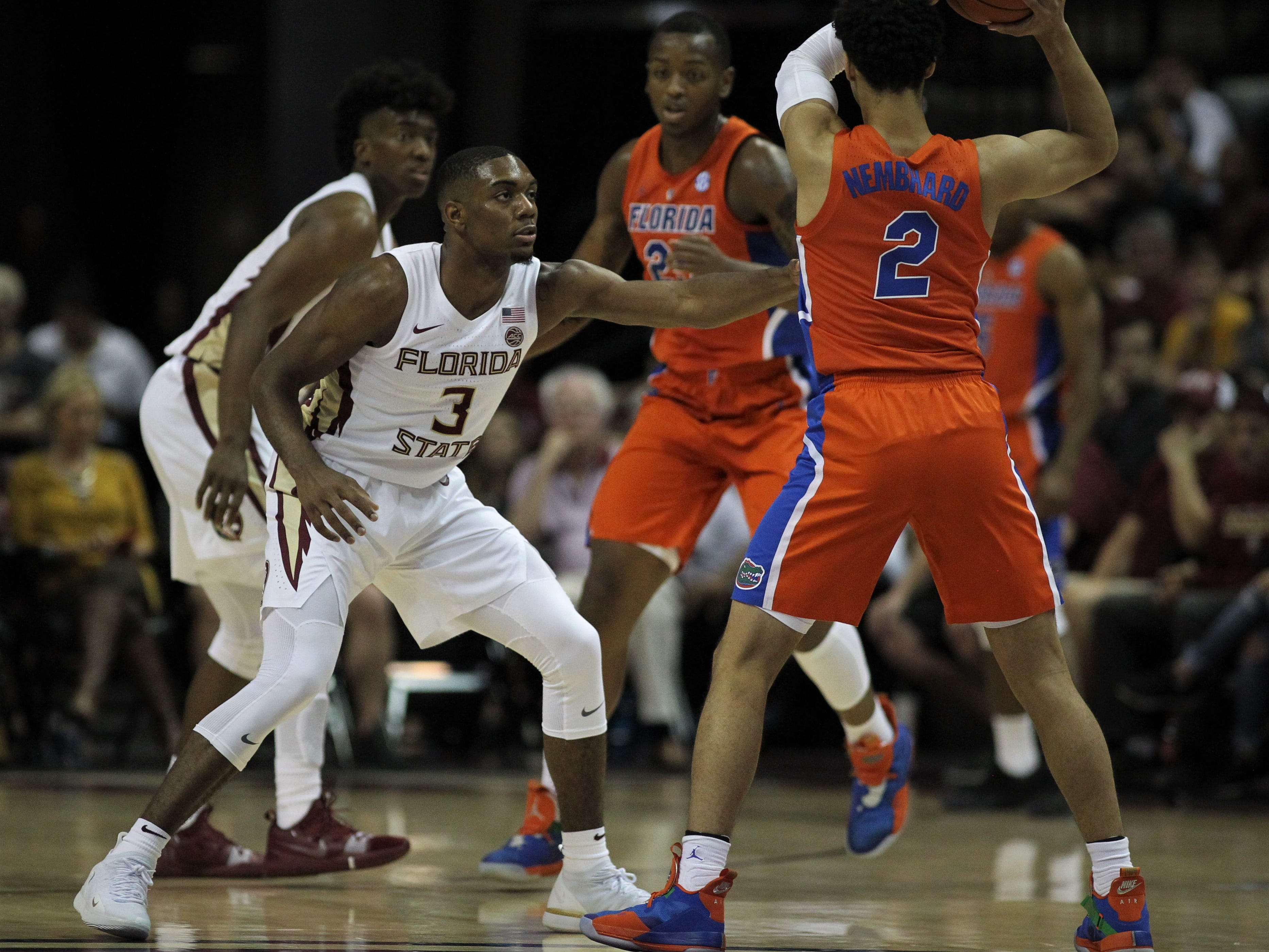 Florida State's Trent Forrest guards Florida's Andrew Nembhard during the Sunshine Showdown game Tuesday at the Tucker Civic Center.