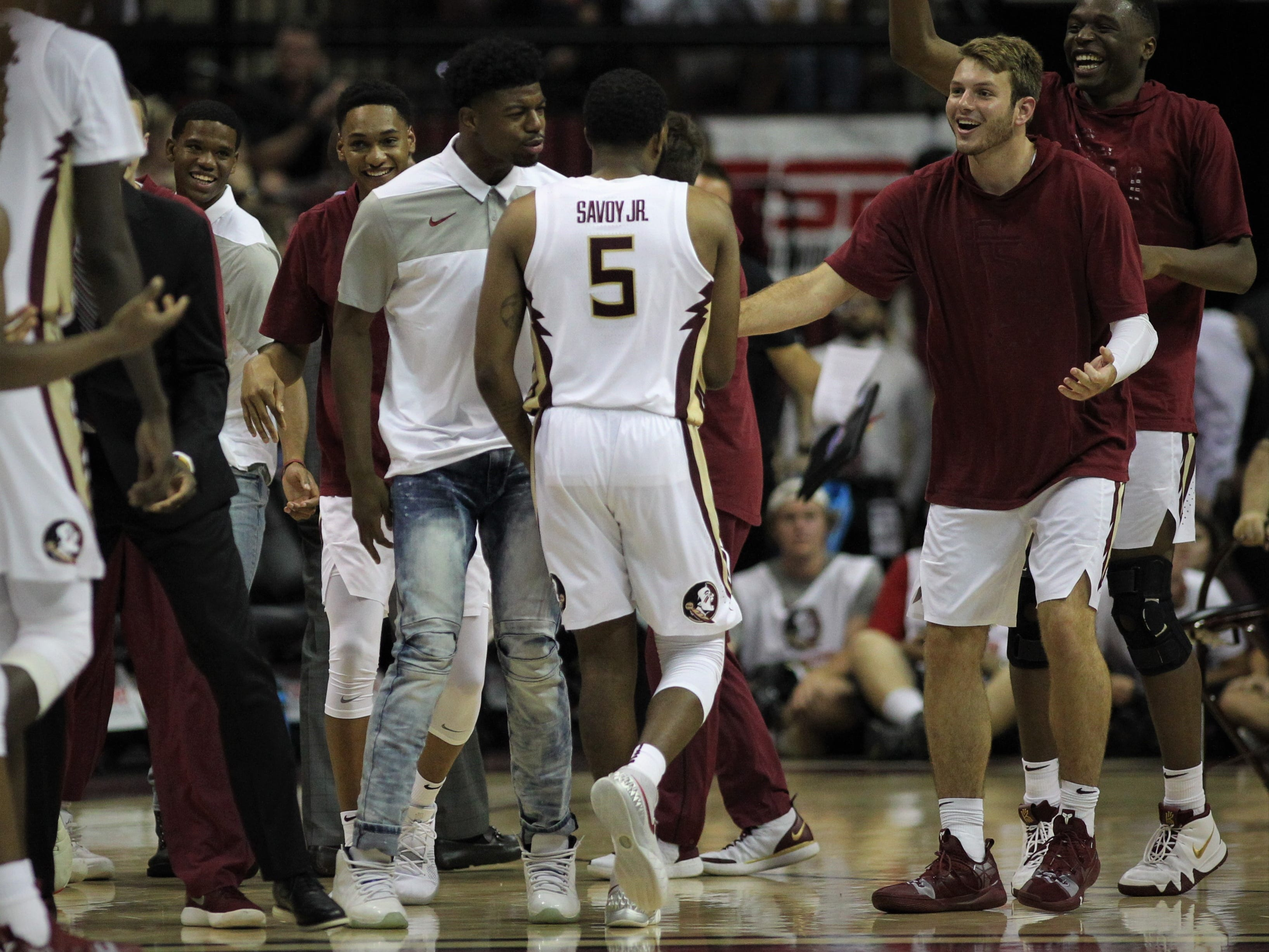 Florida State's P.J. Savoy is congratulated by teammates after hitting his fifth 3-pointer against Florida during the Sunshine Showdown game Tuesday at the Tucker Civic Center.
