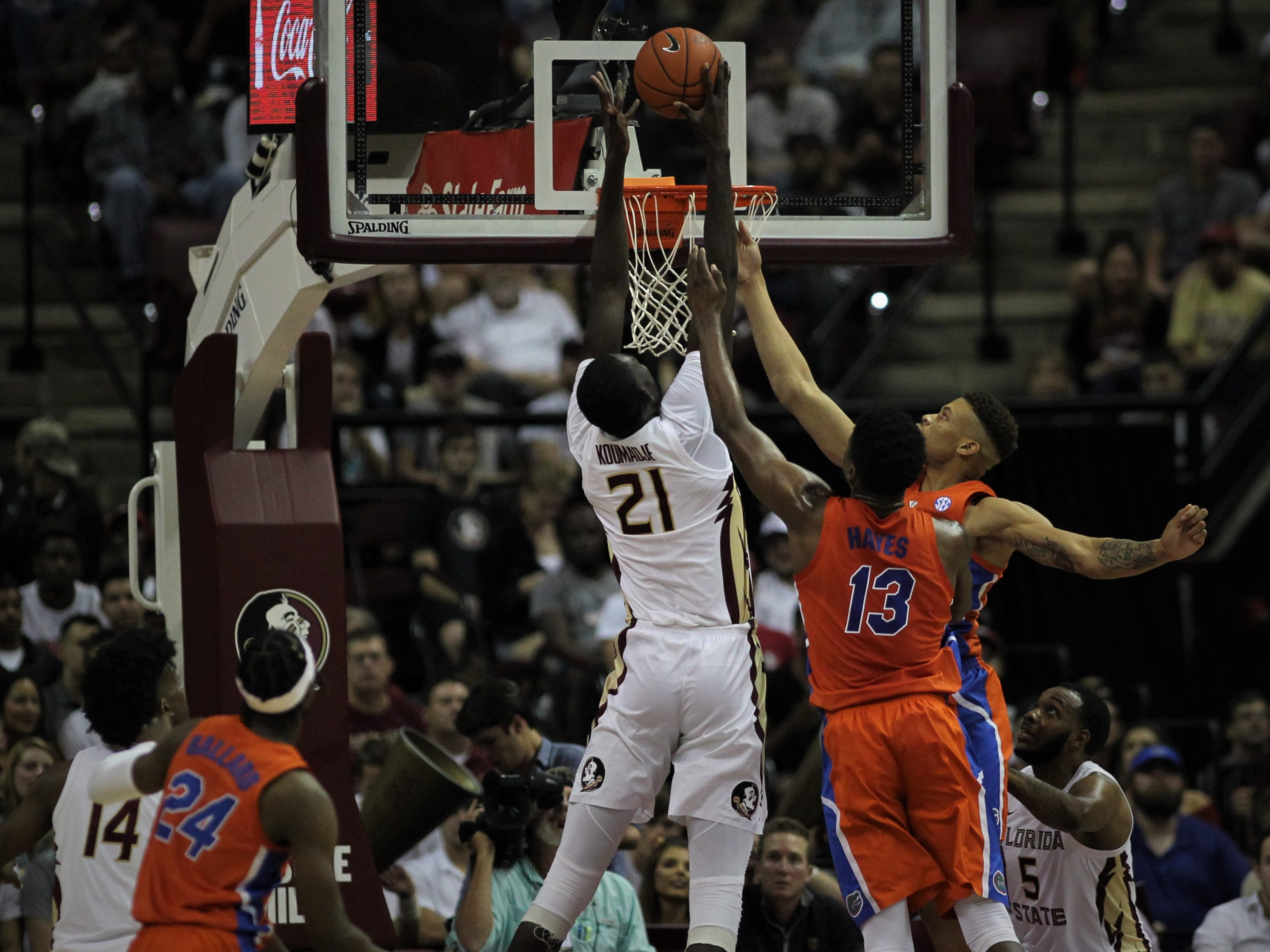Florida State center Christ Koumadje goes up for a rebound during the Sunshine Showdown game against Florida on Tuesday at the Tucker Civic Center.