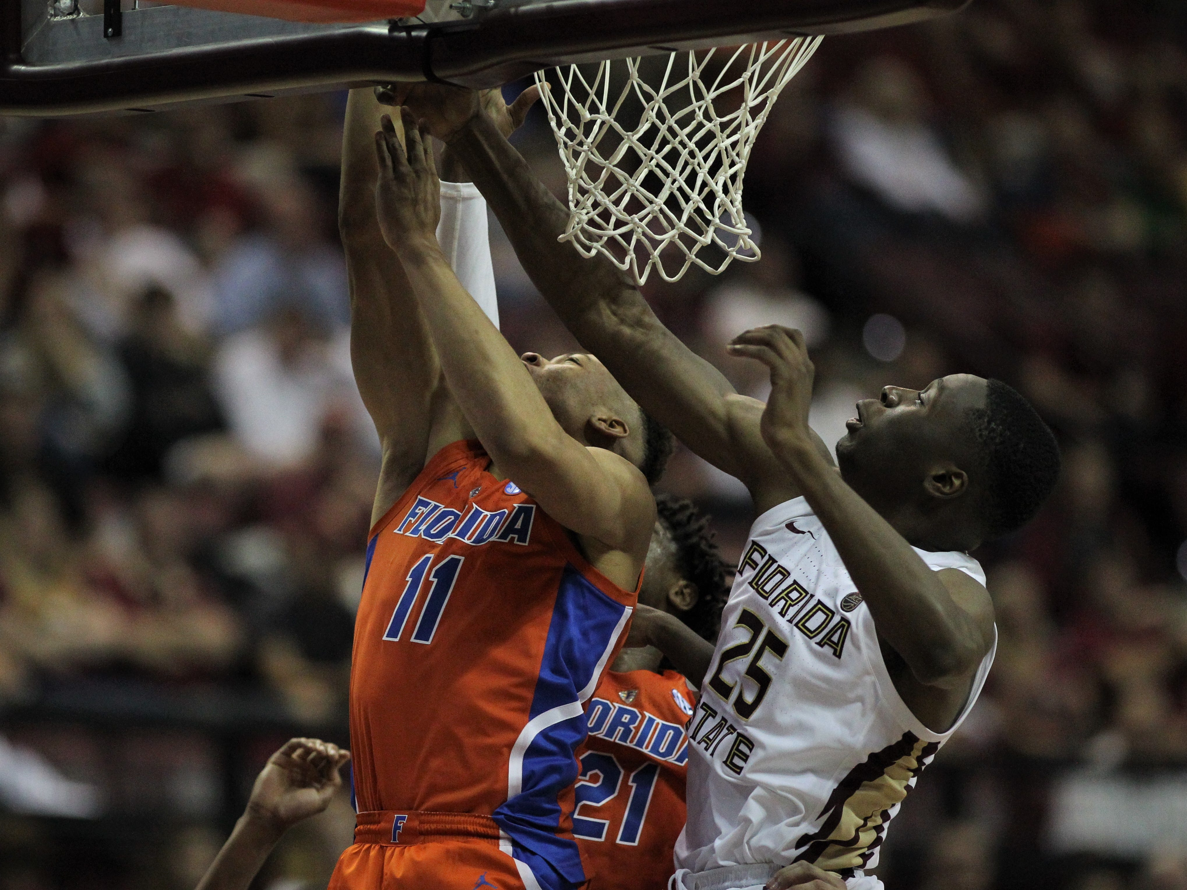 Florida's Keyontae Johnson has his layup disrupted by Florida State's Mfiondu Kabengele during the Sunshine Showdown game Tuesday at the Tucker Civic Center.