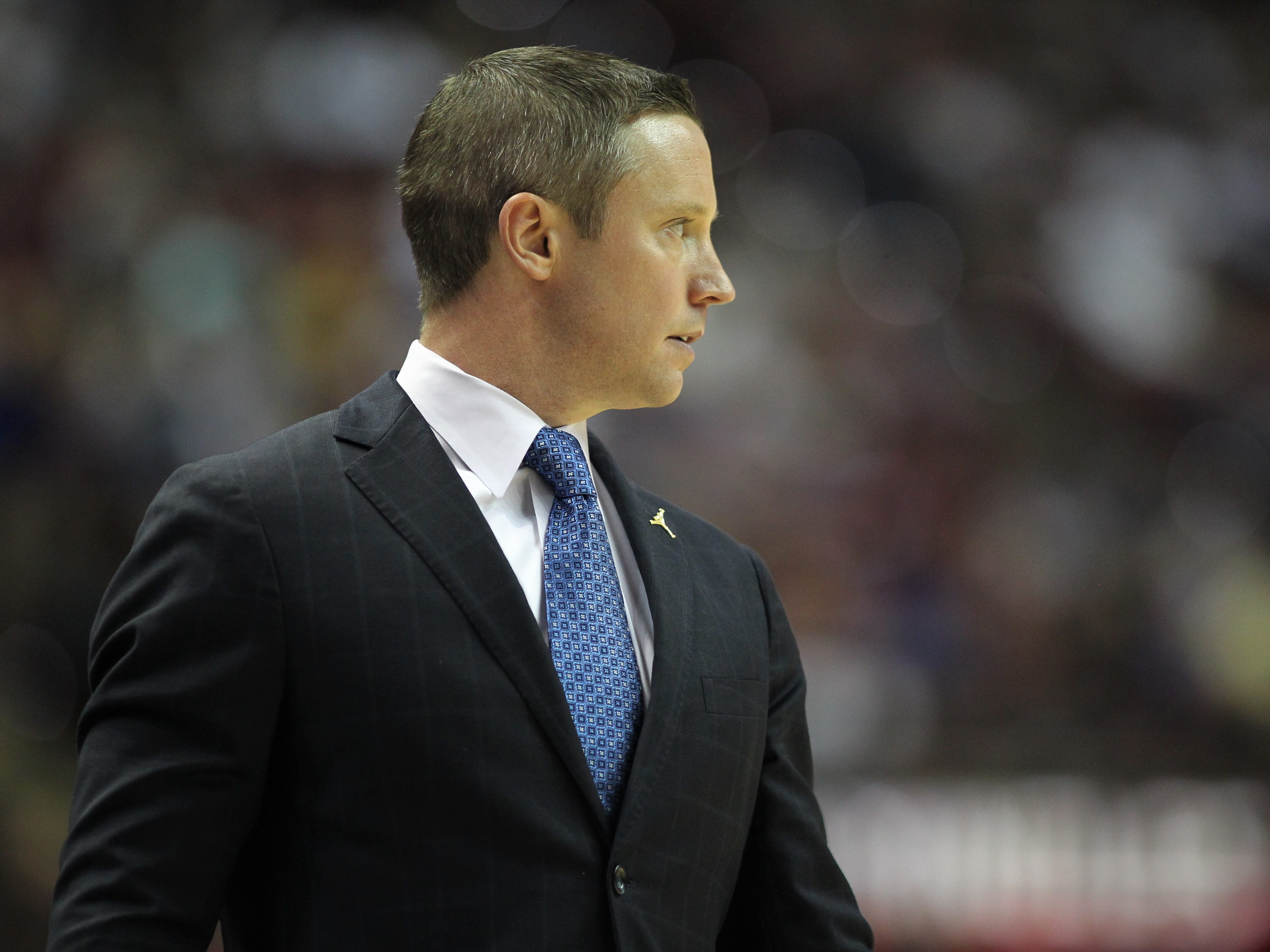Florida men's basketball head coach Mike White watches his team during the Sunshine Showdown game against FSU on Tuesday at the Tucker Civic Center.