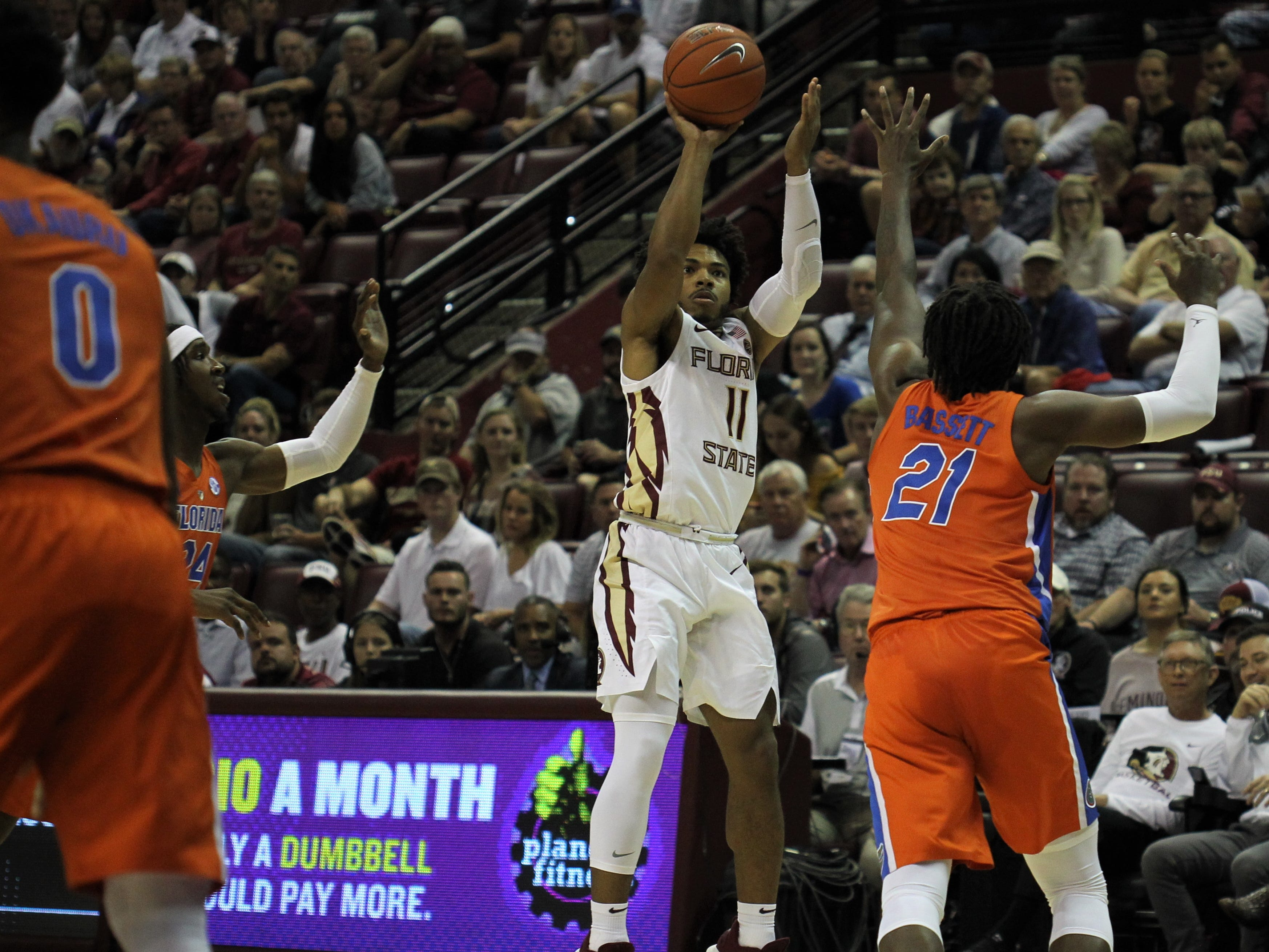 Florida State's David Nichols shoot a 3-pointer against Florida during the Sunshine Showdown game Tuesday at the Tucker Civic Center.