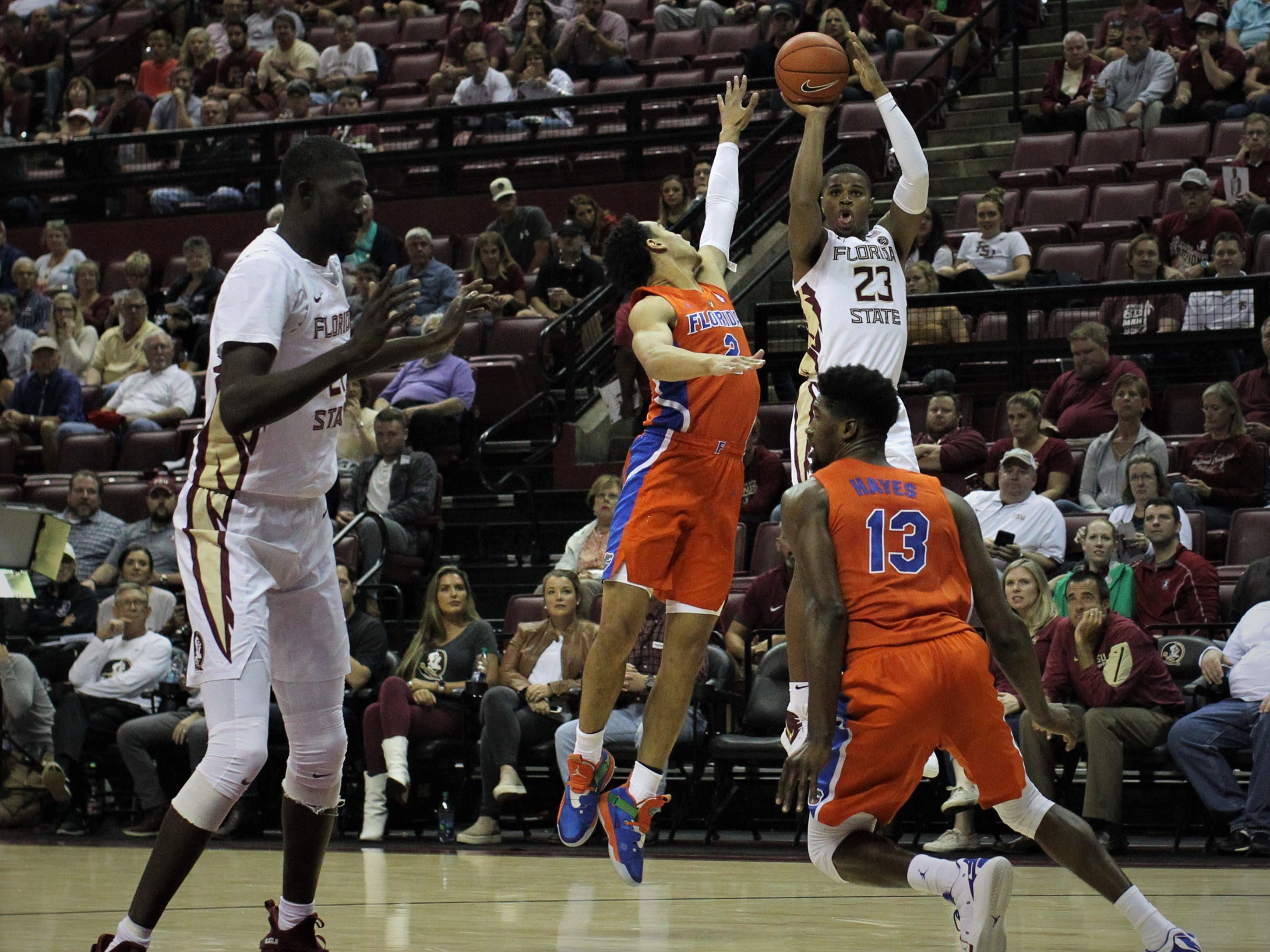 Florida State guard M.J. Walker gets off a 3-pointer over Florida's Jalen Hudson during the Sunshine Showdown game Tuesday at the Tucker Civic Center.