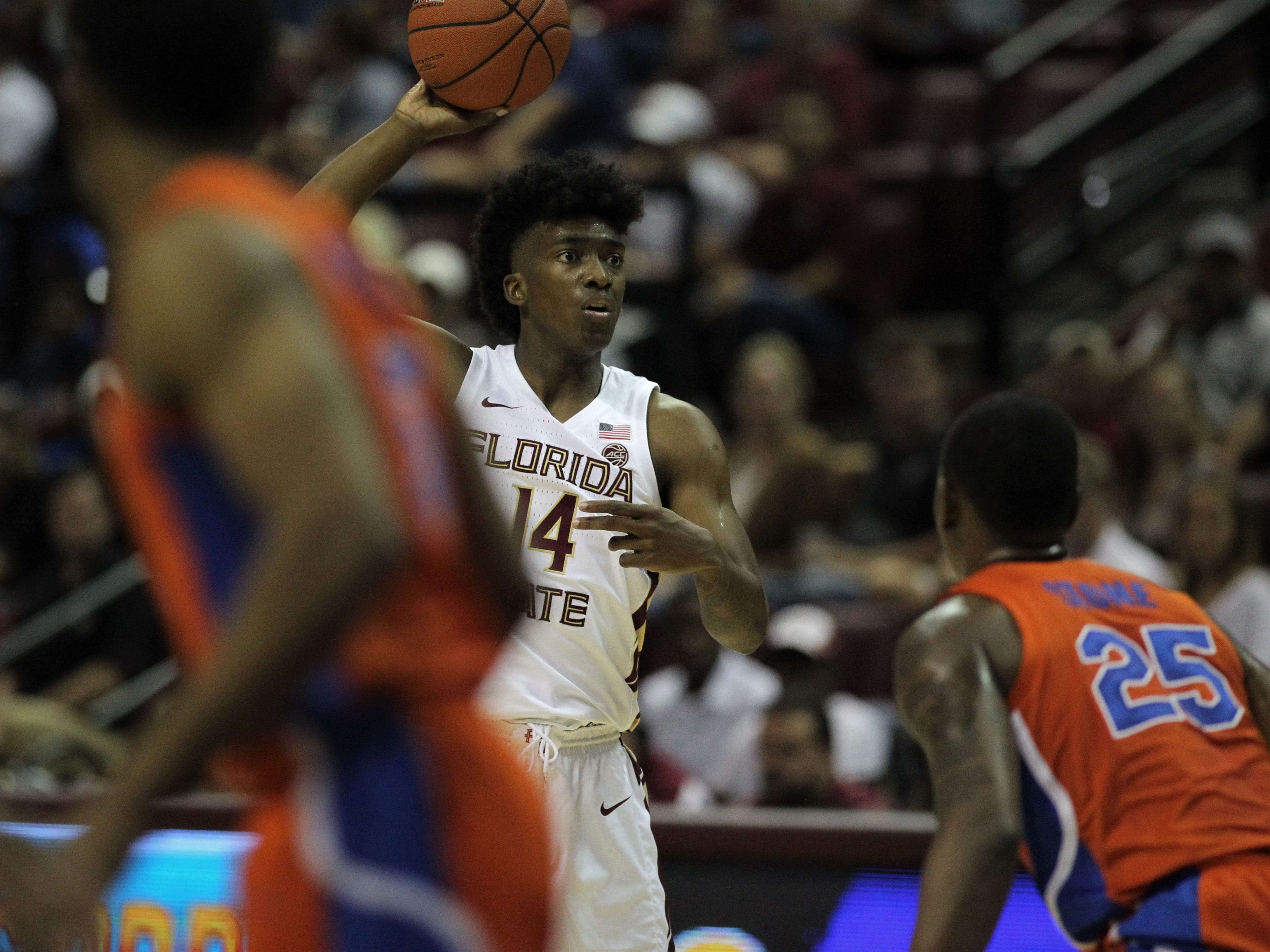 Florida State's Terance Mann looks for a pass during the Sunshine Showdown game against Florida on Tuesday at the Tucker Civic Center.