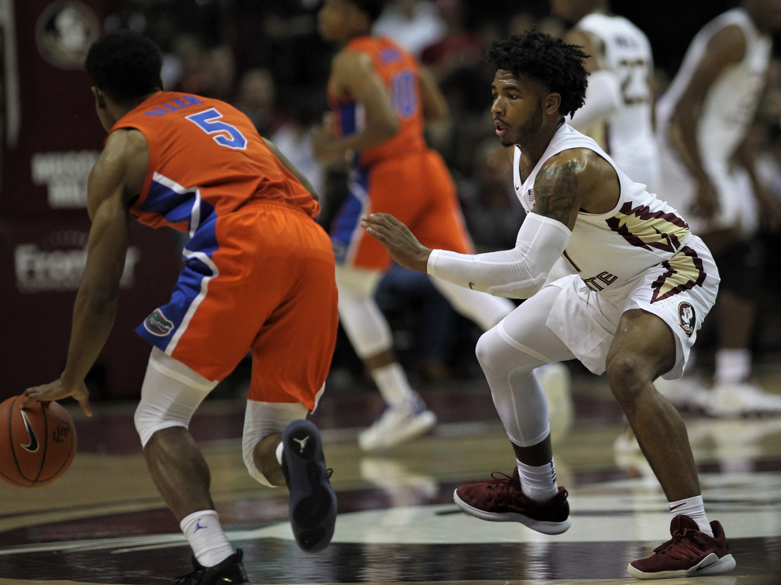 Florida State's David Nichols defends Florida's Kevaughn Allen during the Sunshine Showdown game Tuesday at the Tucker Civic Center.
