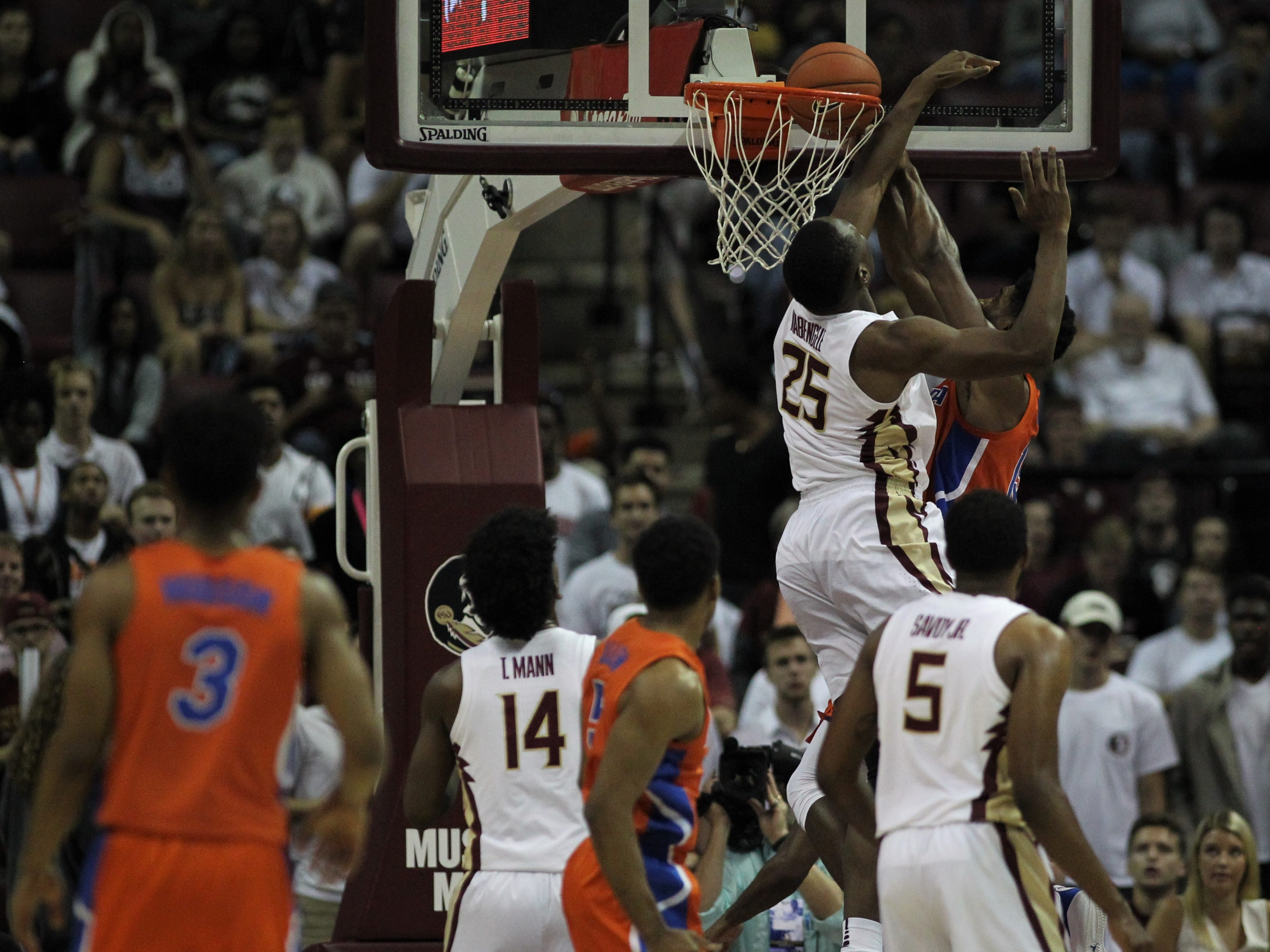 Florida State's Mfiondu Kabengele prevents a Florida dunk during the Sunshine Showdown game Tuesday at the Tucker Civic Center.