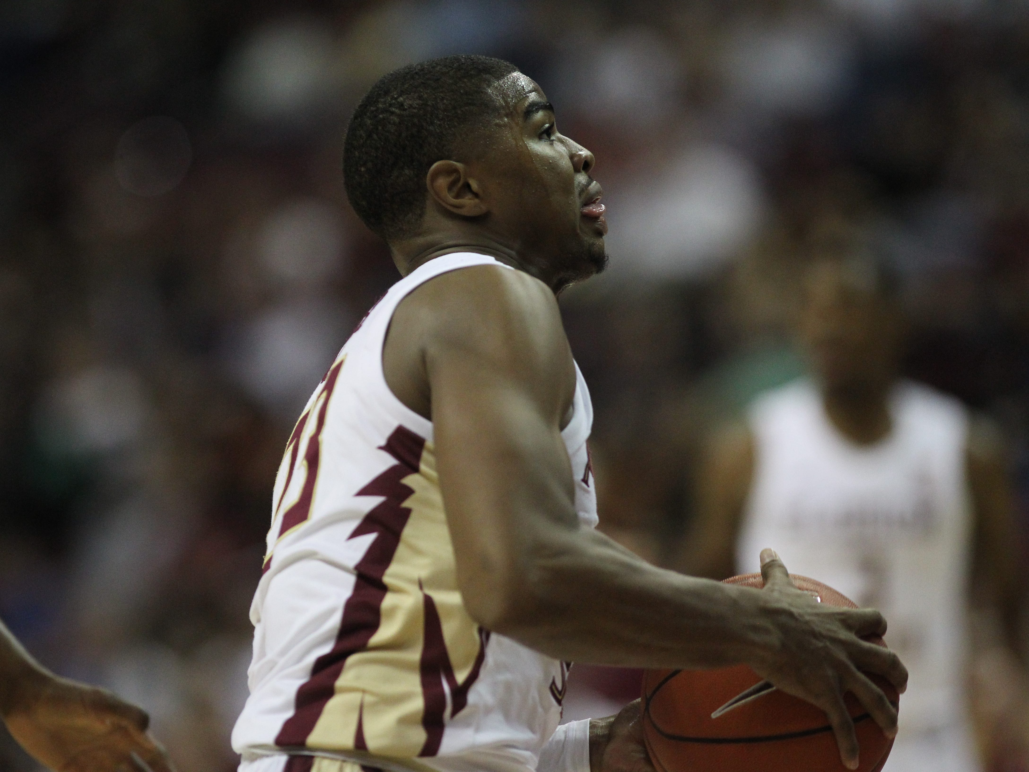 Florida State's M.J. Walker drives to the basket during the Sunshine Showdown game against Florida on Tuesday at the Tucker Civic Center.