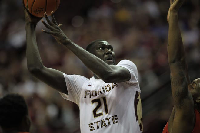 Florida State center Christ Koumadje takes a hook shot over a Florida defender during the Sunshine Showdown game Tuesday at the Tucker Civic Center.