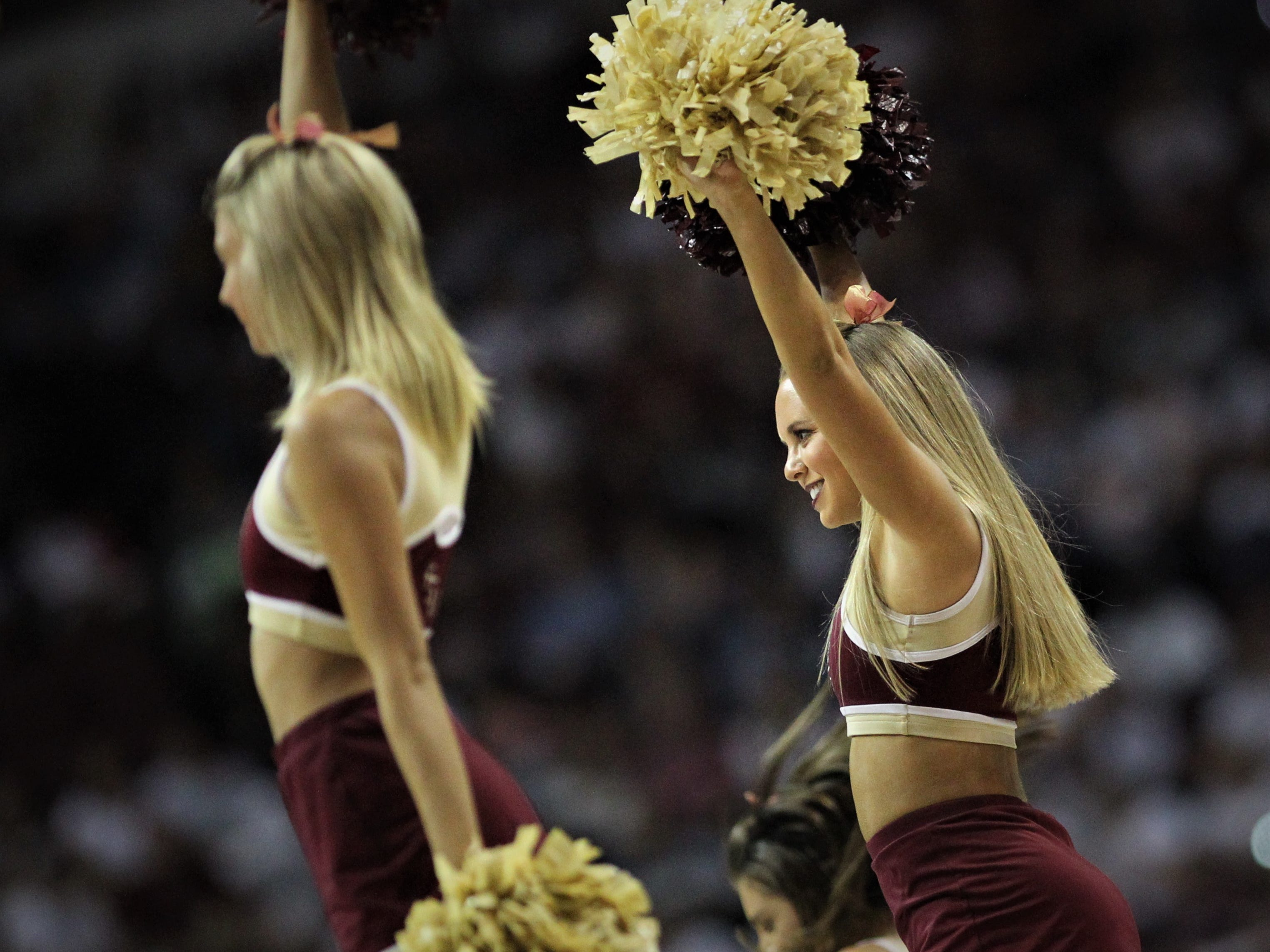 FSU's cheerleaders lead the crowd during the Sunshine Showdown game against Florida on Tuesday at the Tucker Civic Center.