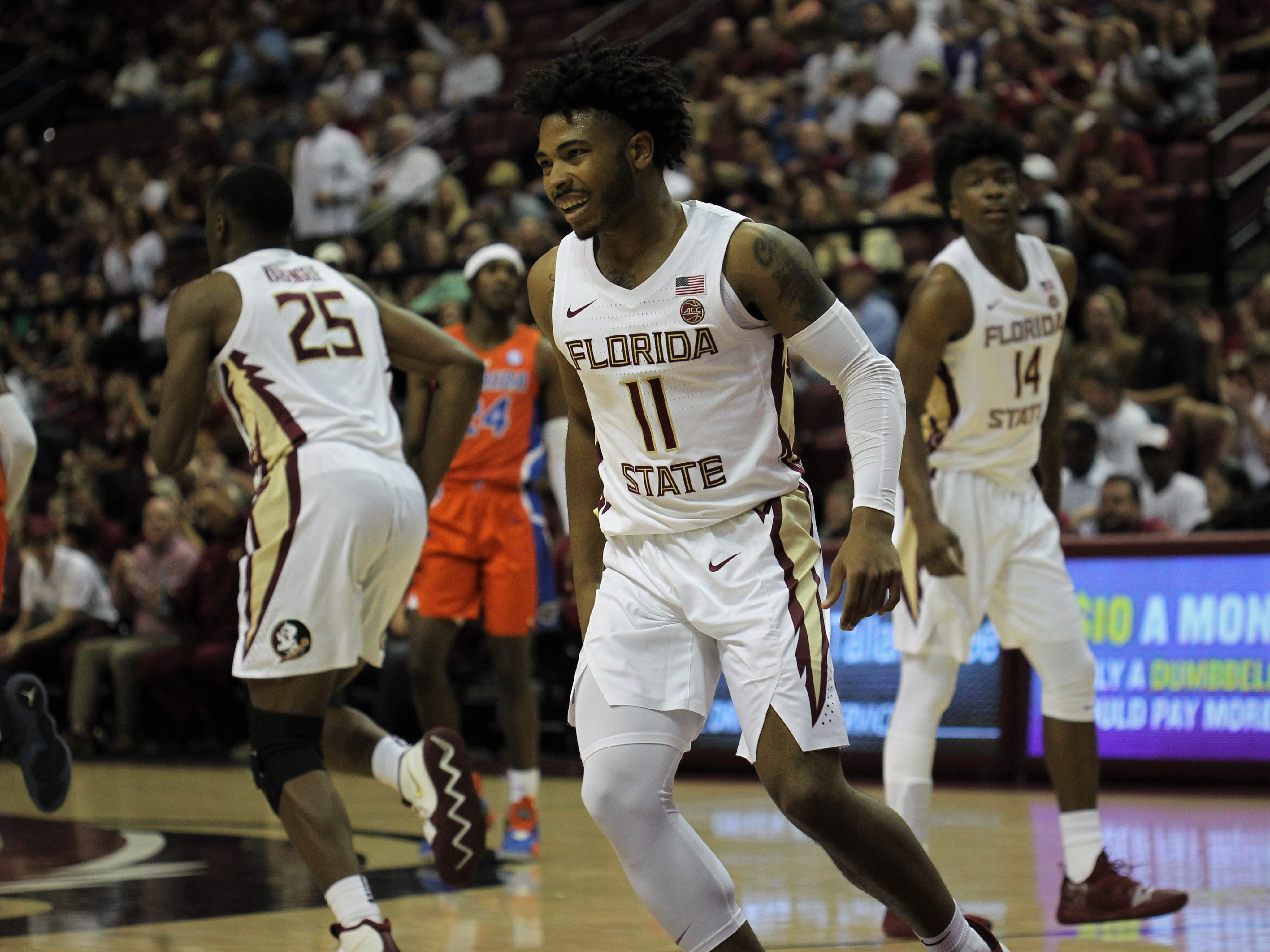 Florida State's David Nichols reacts to P.J. Savoy's made 3-pointer during the Sunshine Showdown game Tuesday at the Tucker Civic Center.
