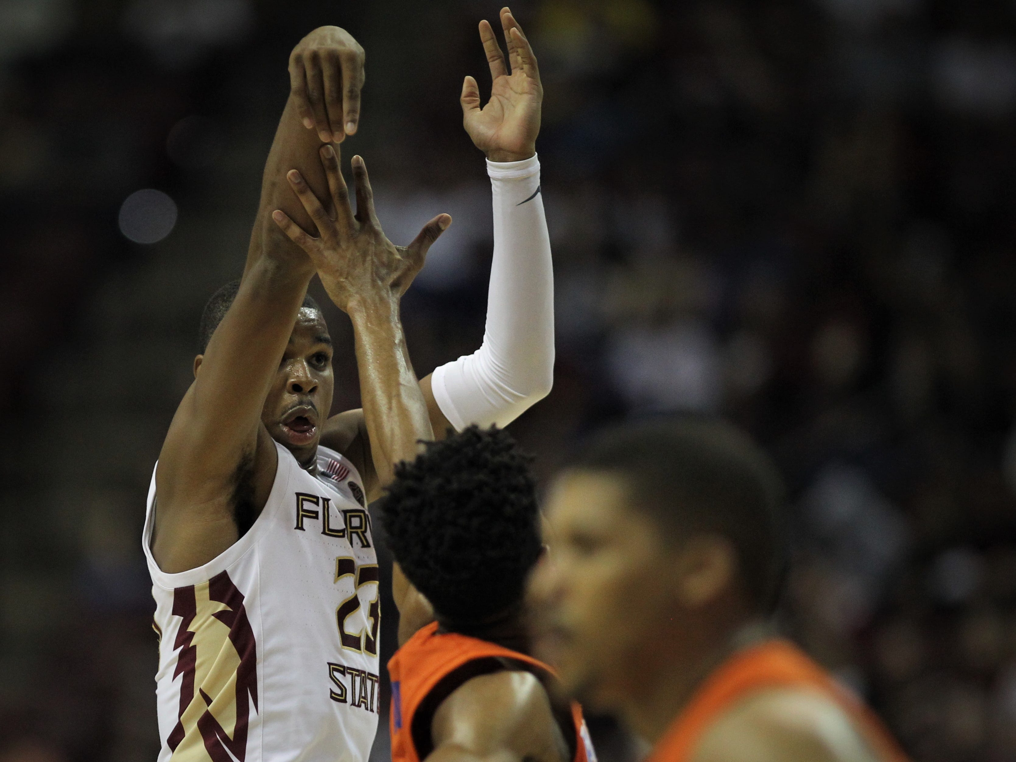 Florida State's M.J. Walker watches a 3-pointer during the Sunshine Showdown game against Florida on Tuesday at the Tucker Civic Center.