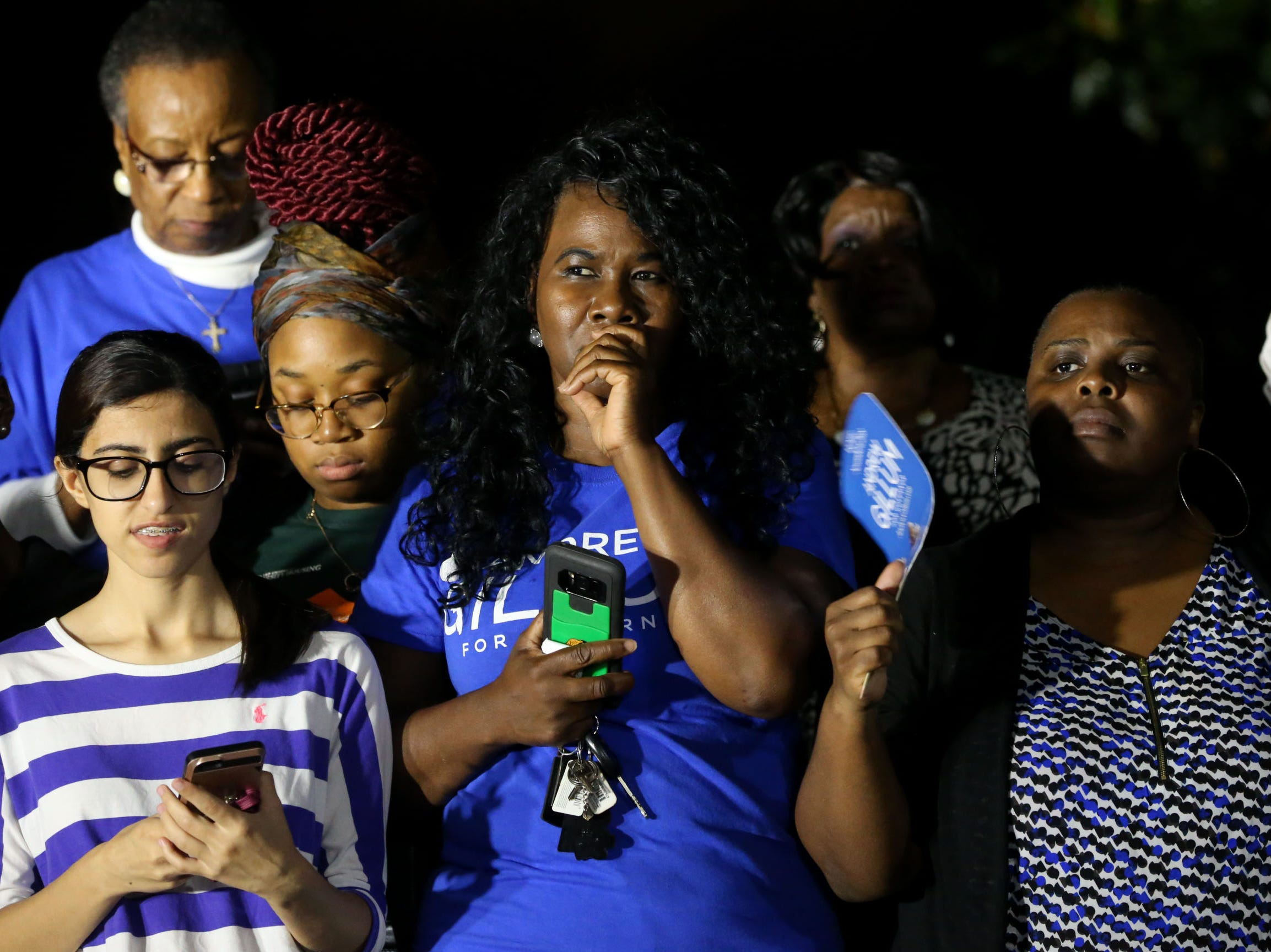 Supporters of Andrew Gillum begin to feel discouraged as the polls are updated while at Gillum's watch party outside Lee Hall on the Florida A&M campus, on Election night, Tuesday, Nov. 6, 2018.