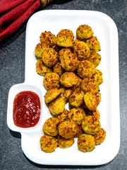 Easy Cheesy Zucchini Bites are a vegetarian alternative to sausce balls.