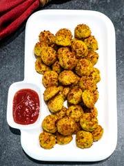 Easy Cheesy Zucchini Bites are a vegetarian alternative to sausce balls.