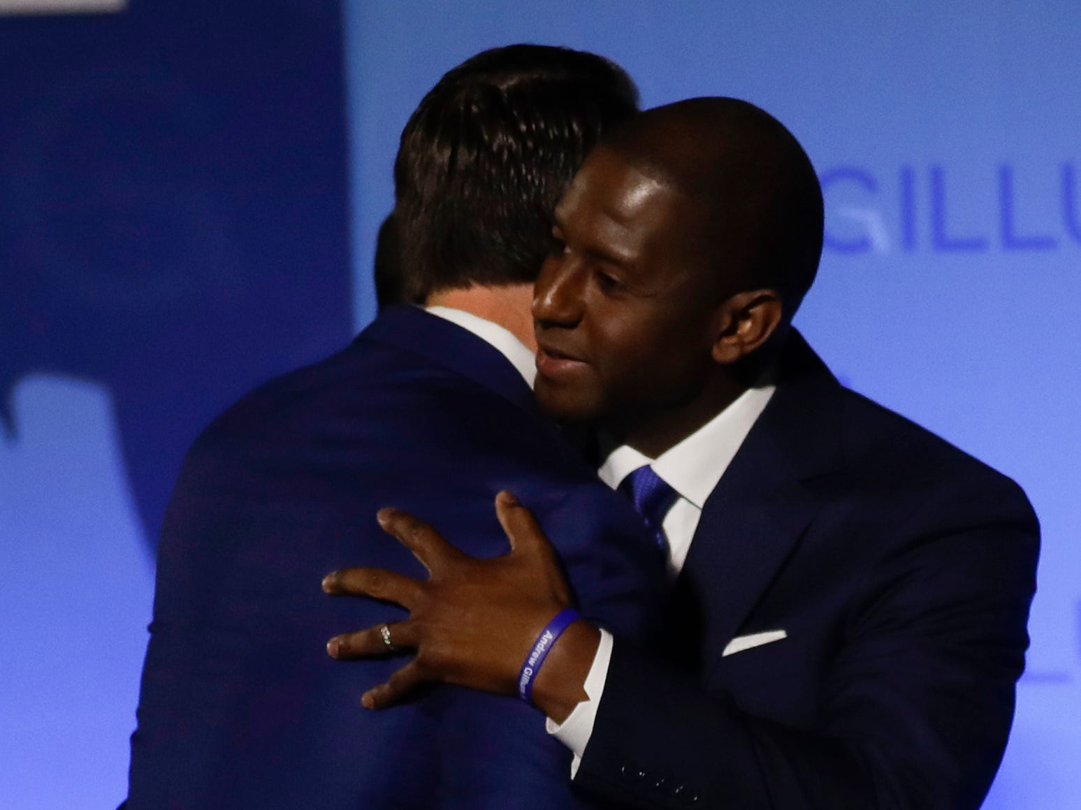 Andrew Gillum embraces his running mate Chris King as he makes his concession speech in front of Lee Hall on the Florida A&M campus in Tallahassee, Fla. after losing the governor's race to Ron DeSantis Tuesday, Nov. 6, 2018.