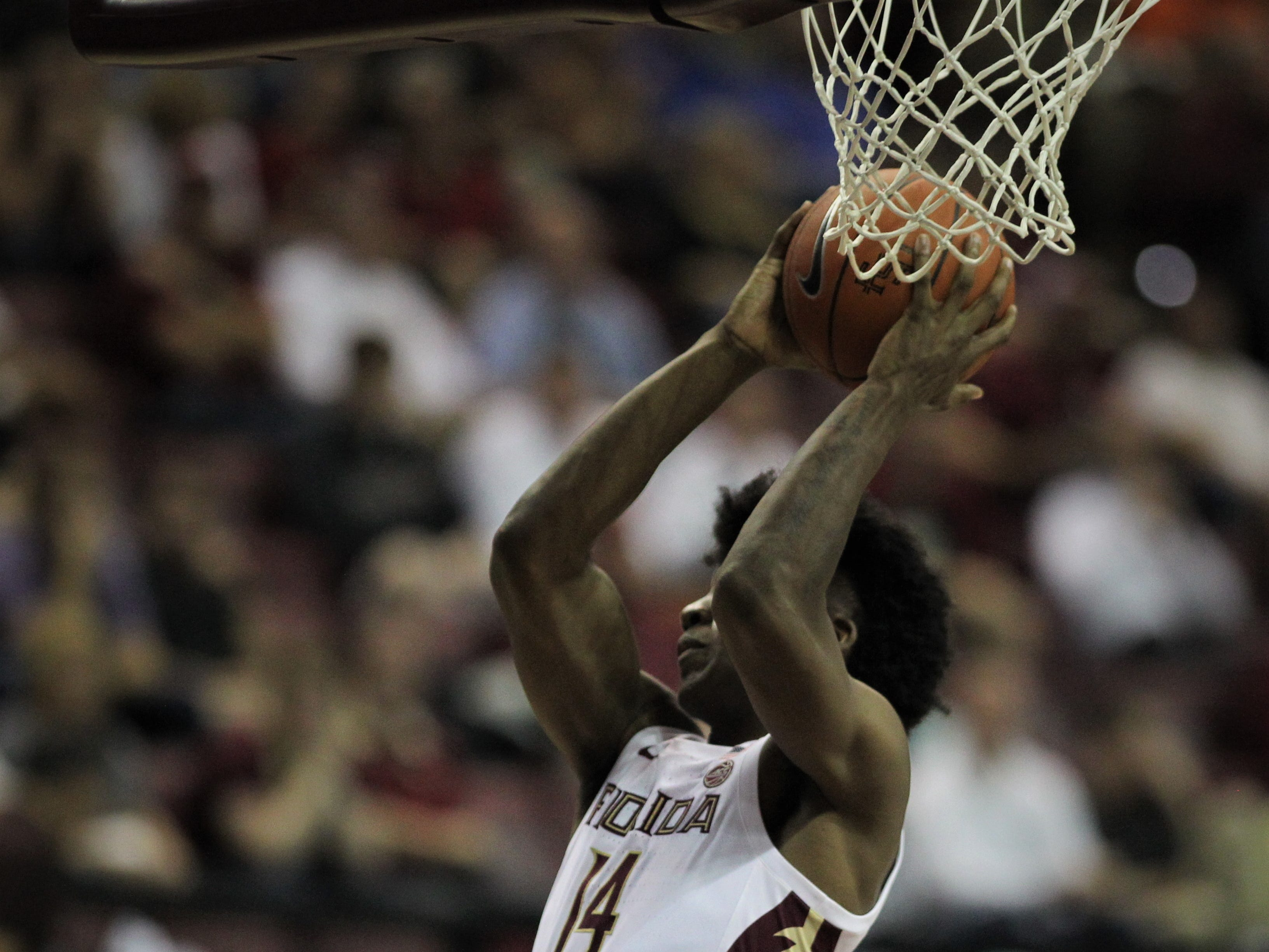 Florida State's Terance Mann grabs a rebounds against Florida during the Sunshine Showdown game Tuesday at the Tucker Civic Center.