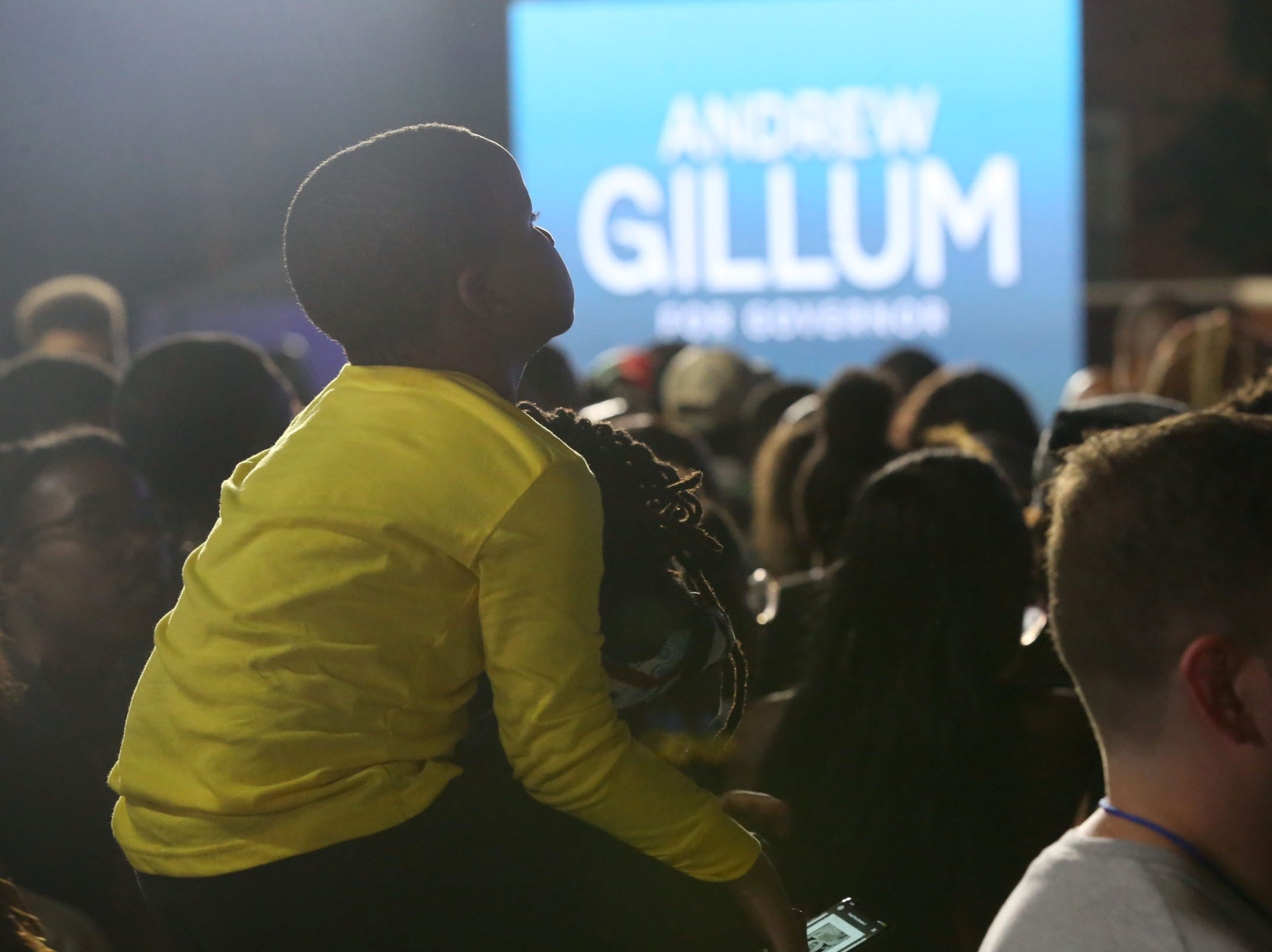 Spirits are high and supporters of Andrew Gillum show off their front row seat while at Gillum's watch party outside Lee Hall on the Florida A&M campus, on Election night, Tuesday, Nov. 6, 2018.