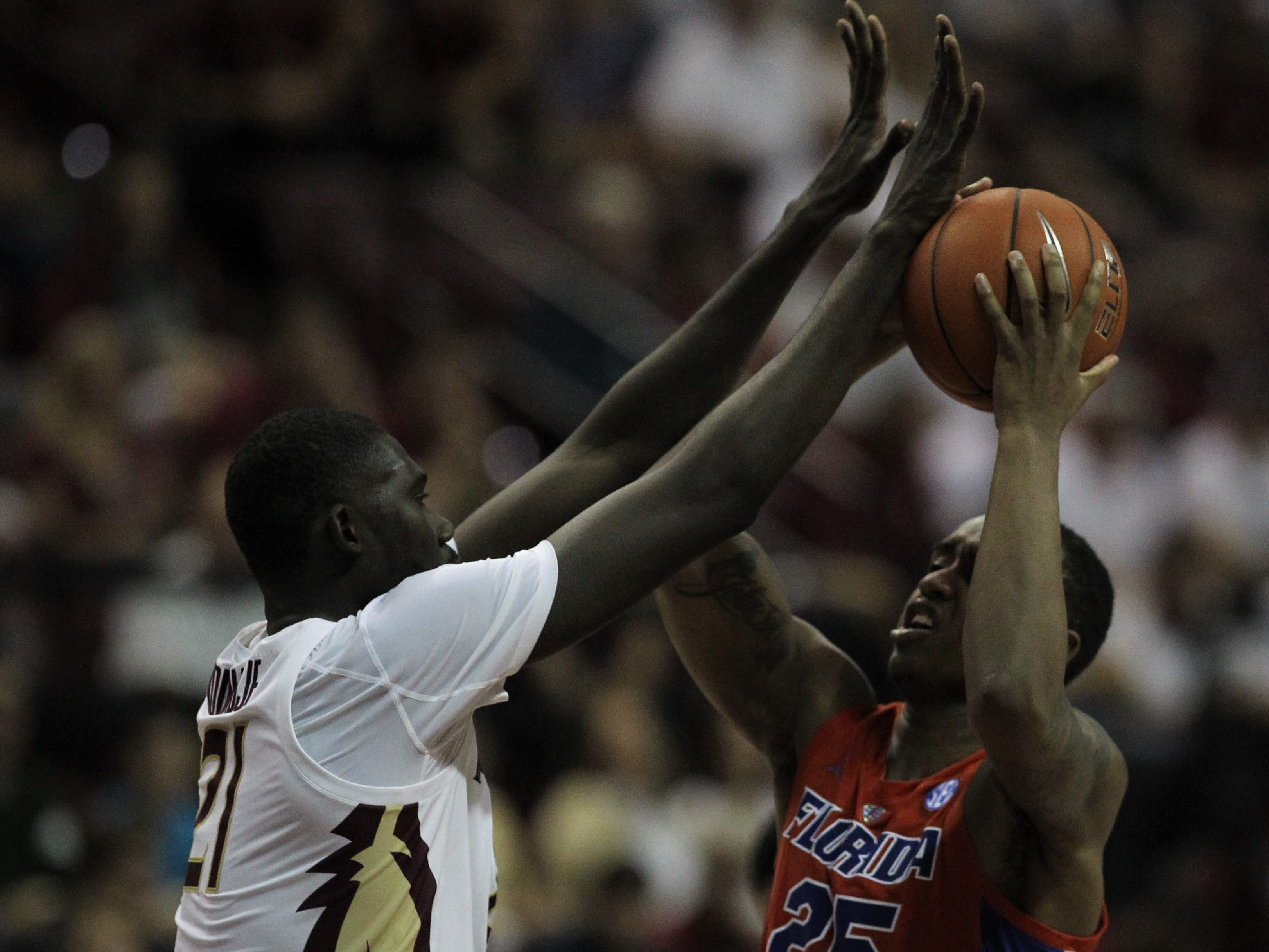 Florida's Keith Stone has his shot disrupted by Florida State center Christ Koumadje during the Sunshine Showdown game Tuesday at the Tucker Civic Center.