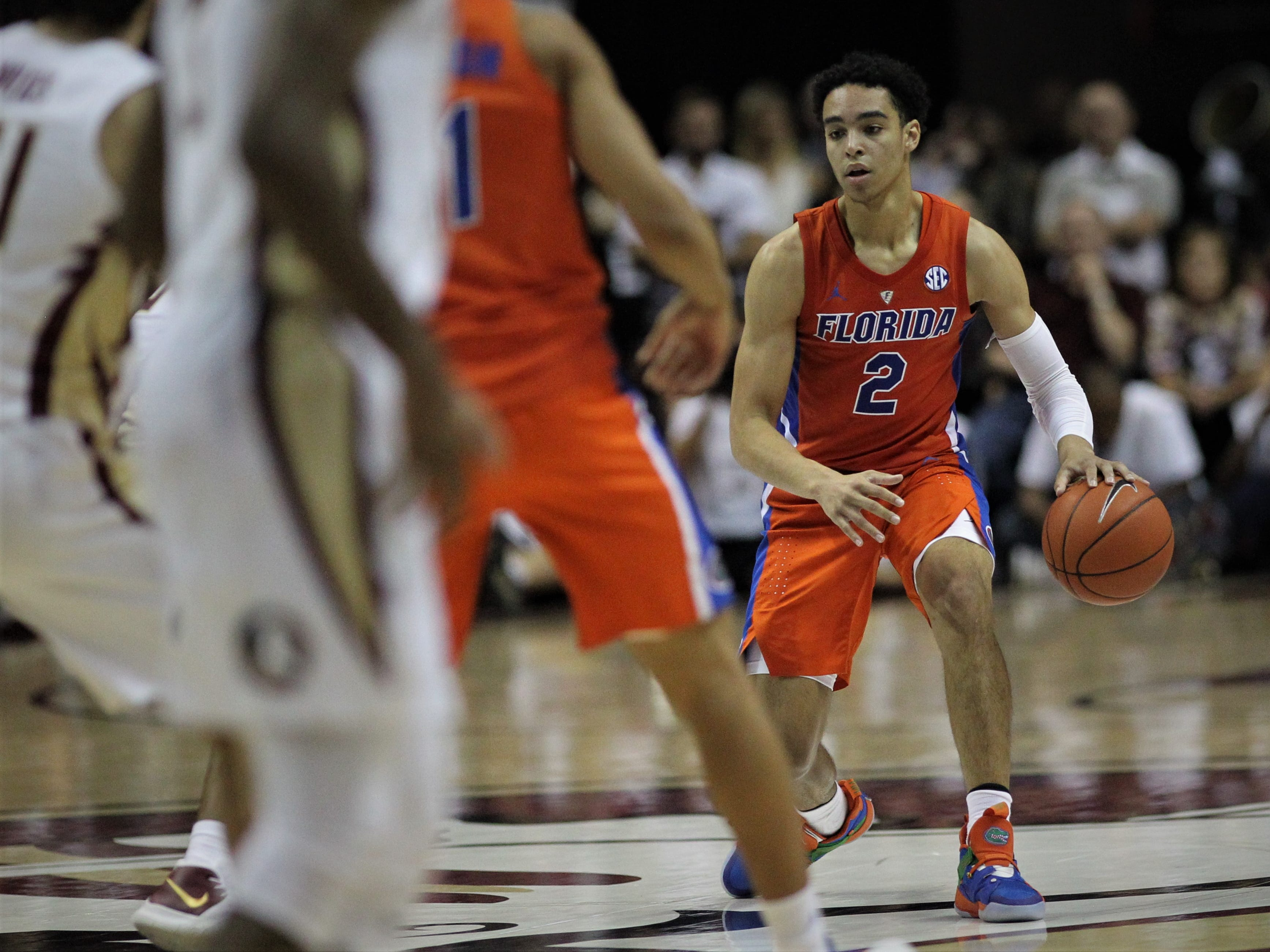 Florida's Andrew Nembhard looks for room against FSU during the Sunshine Showdown game Tuesday at the Tucker Civic Center.