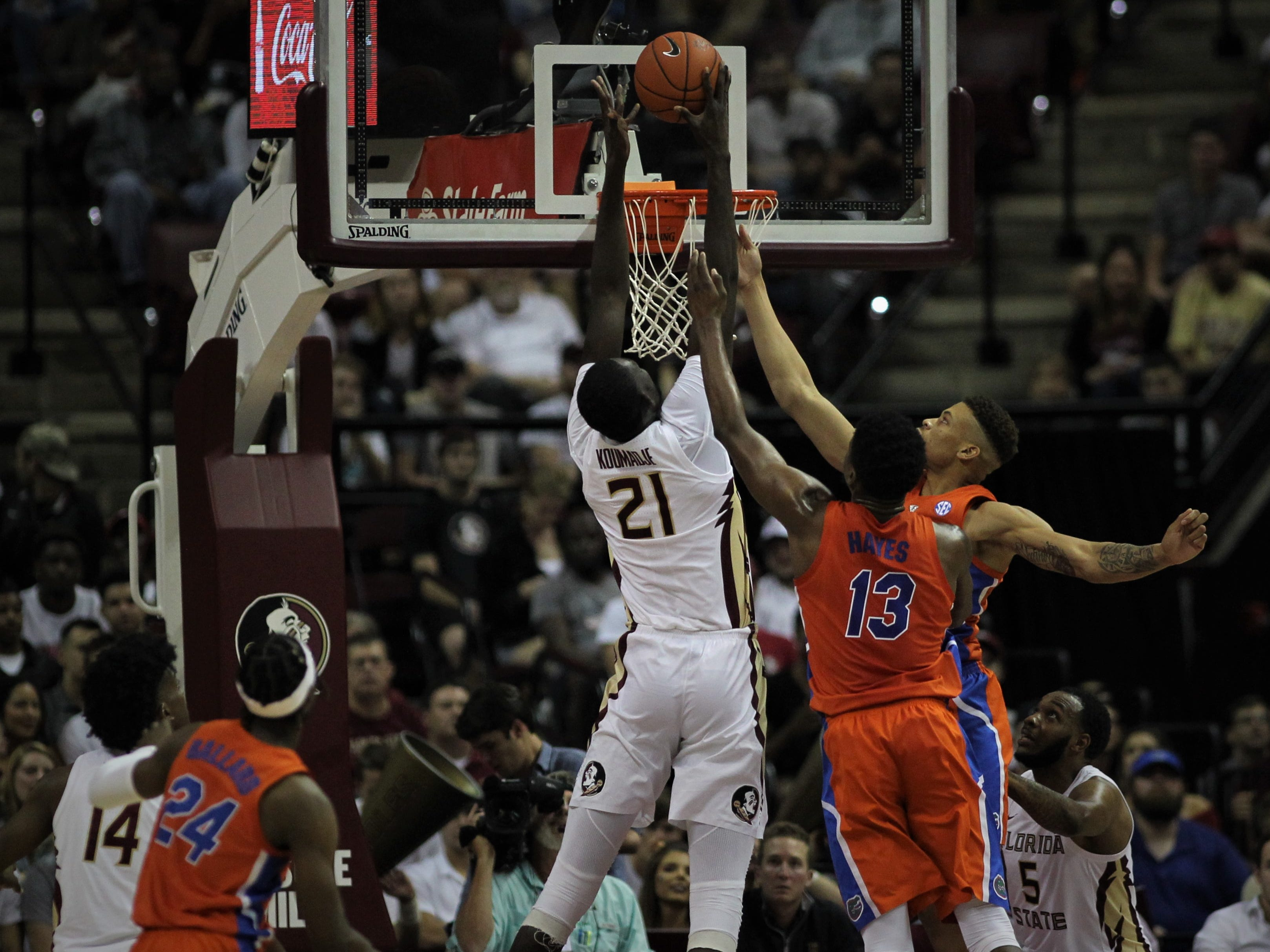 Florida State center Christ Koumadje goes up above the rim for a rebound during the Sunshine Showdown game against Florida on Tuesday at the Tucker Civic Center.