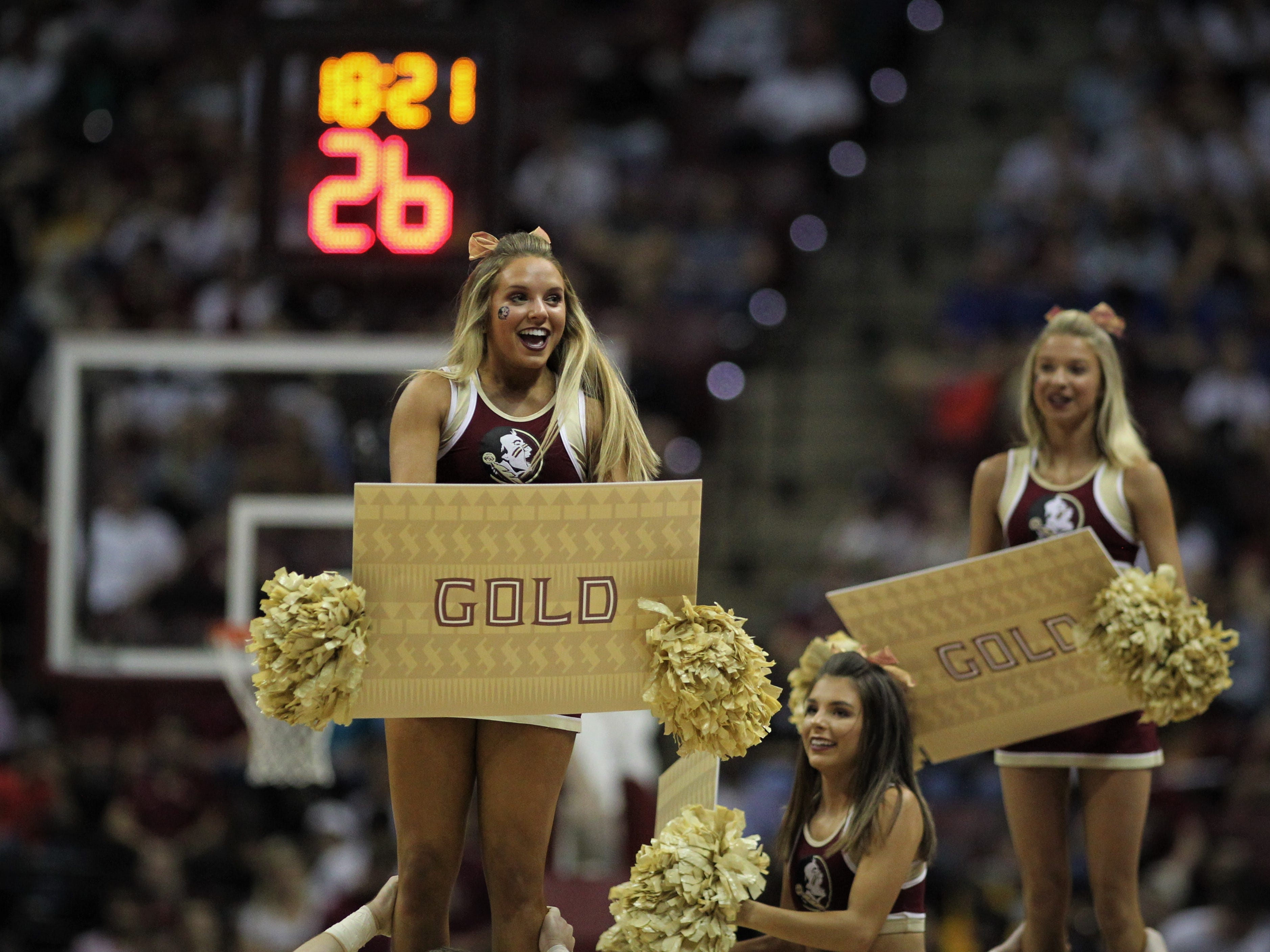 FSU's cheerleaders lead a Garnet & Gold cheer during the Sunshine Showdown game Tuesday at the Tucker Civic Center.