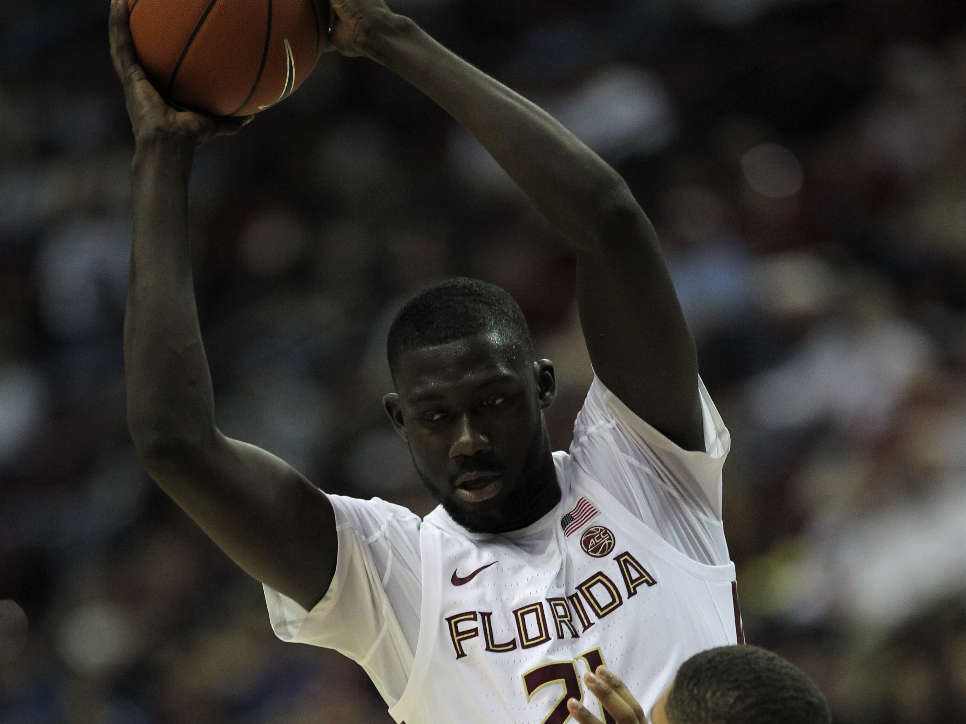 Florida State center Christ Koumadje works against Florida's Isaiah Stokes during the Sunshine Showdown game Tuesday at the Tucker Civic Center.