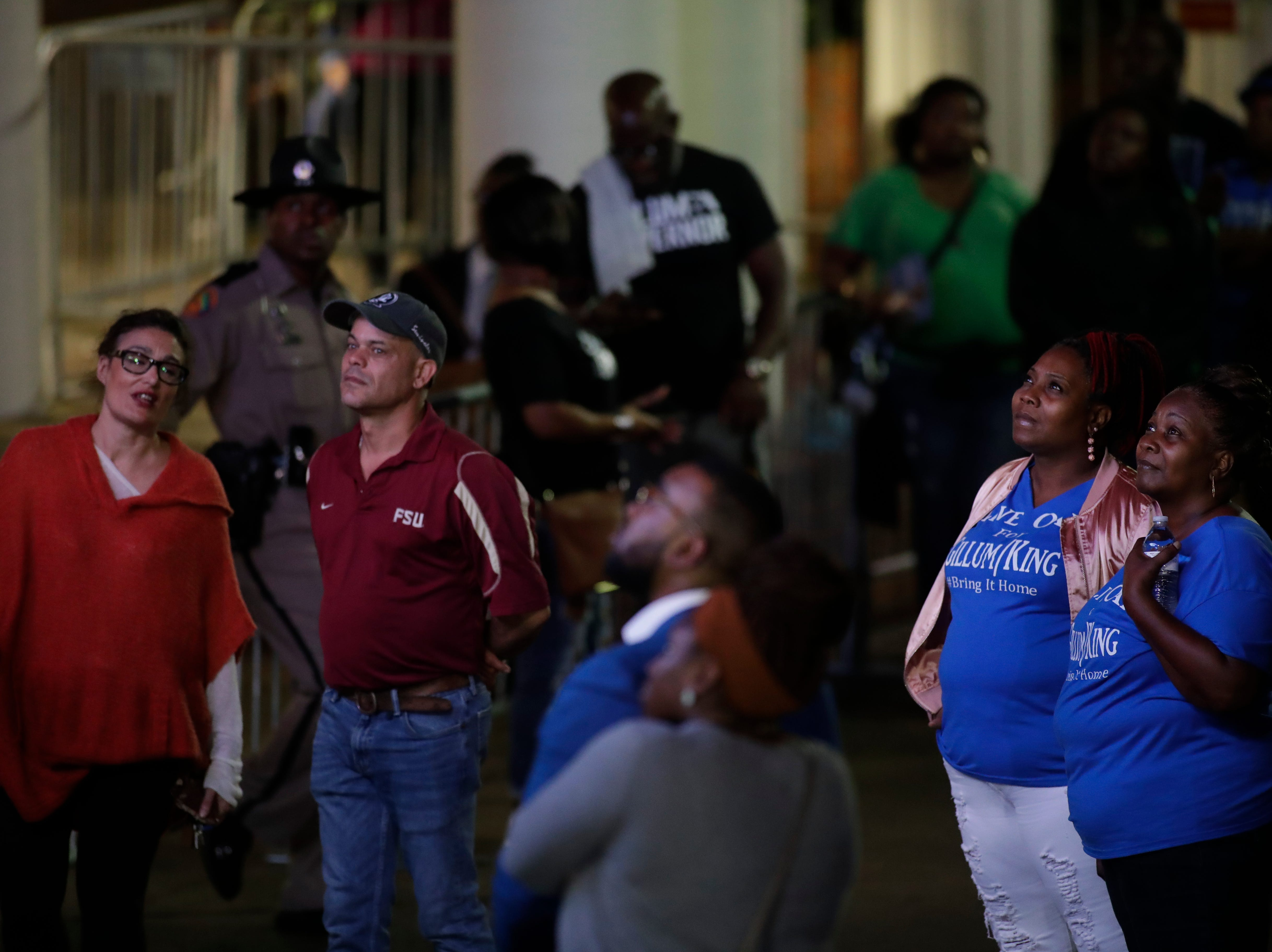 Supporters await the appearance of Andrew Gillum and the results of the midterm elections in front of Lee Hall on the Florida A&M campus in Tallahassee, Fla. Tuesday, Nov. 6, 2018.