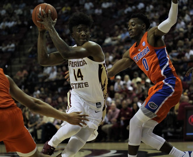 Florida State guard Terance Mann drives on Florida's Mike Okauru during the first half of the Sunshine Showdown game Tuesday night at the Tucker Civic Center.