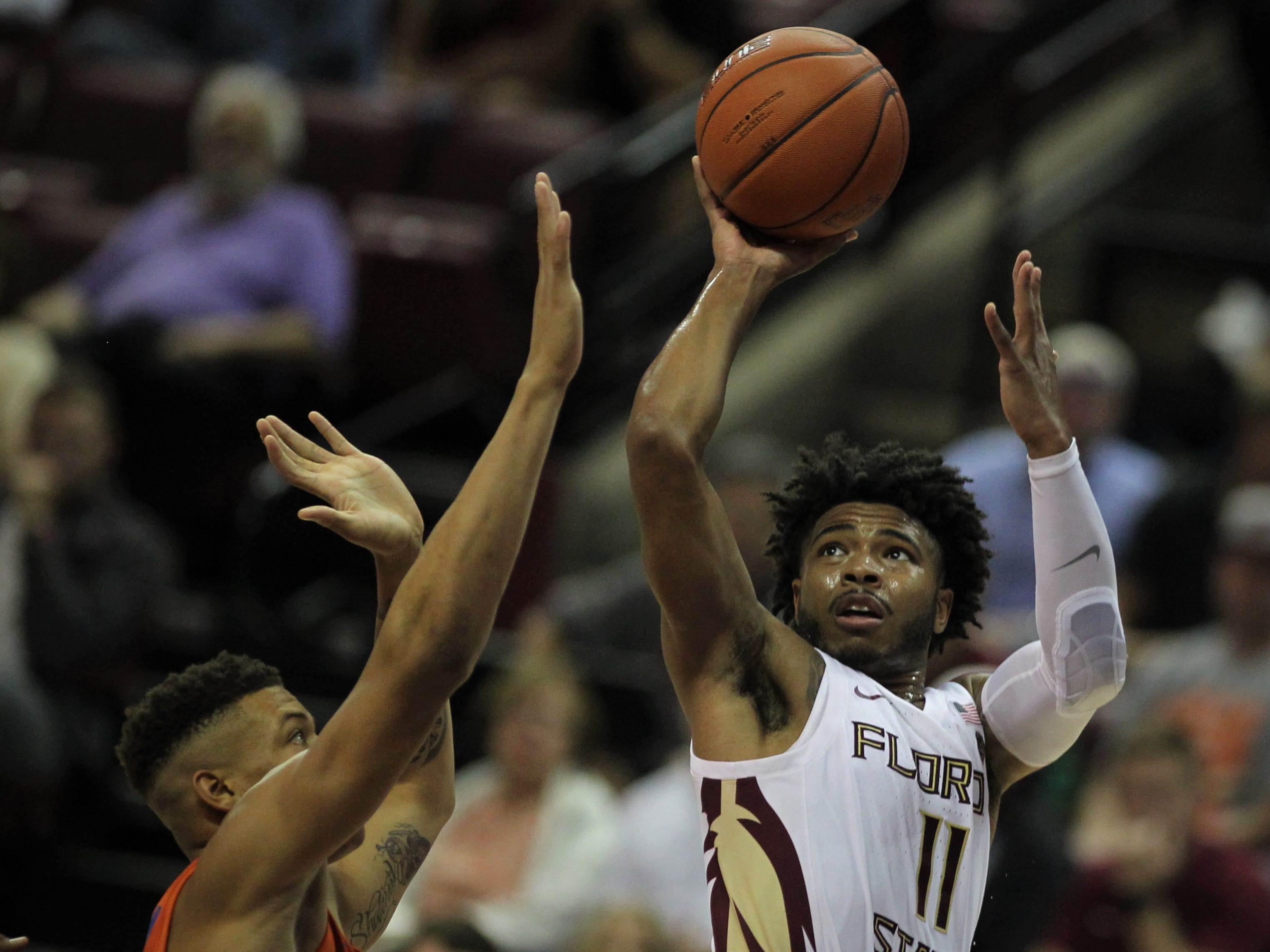 Florida State guard David Nichols shoots over Florida's Keyontae Johnson during the Sunshine Showdown game Tuesday at the Tucker Civic Center.