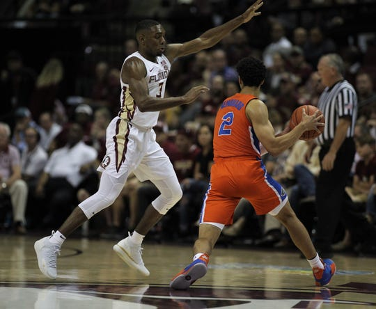 Florida State's Trent Forrest defends Florida's Andrew Nembhard during the Sunshine Showdown game Tuesday at the Tucker Civic Center.