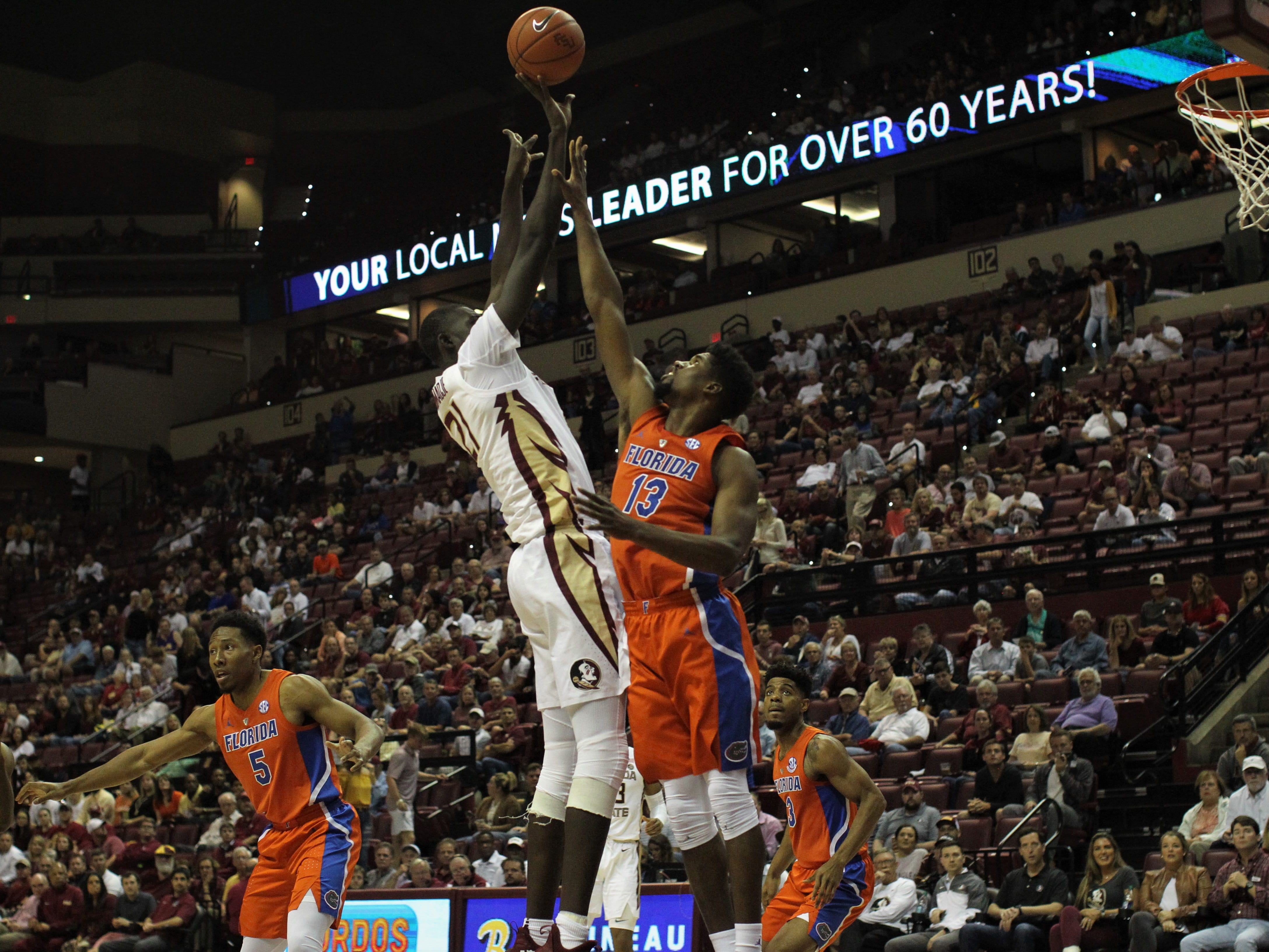 Florida State center Christ Koumadje puts together a post move against Florida's Anthony Polite during the Sunshine Showdown game Tuesday at the Tucker Civic Center.