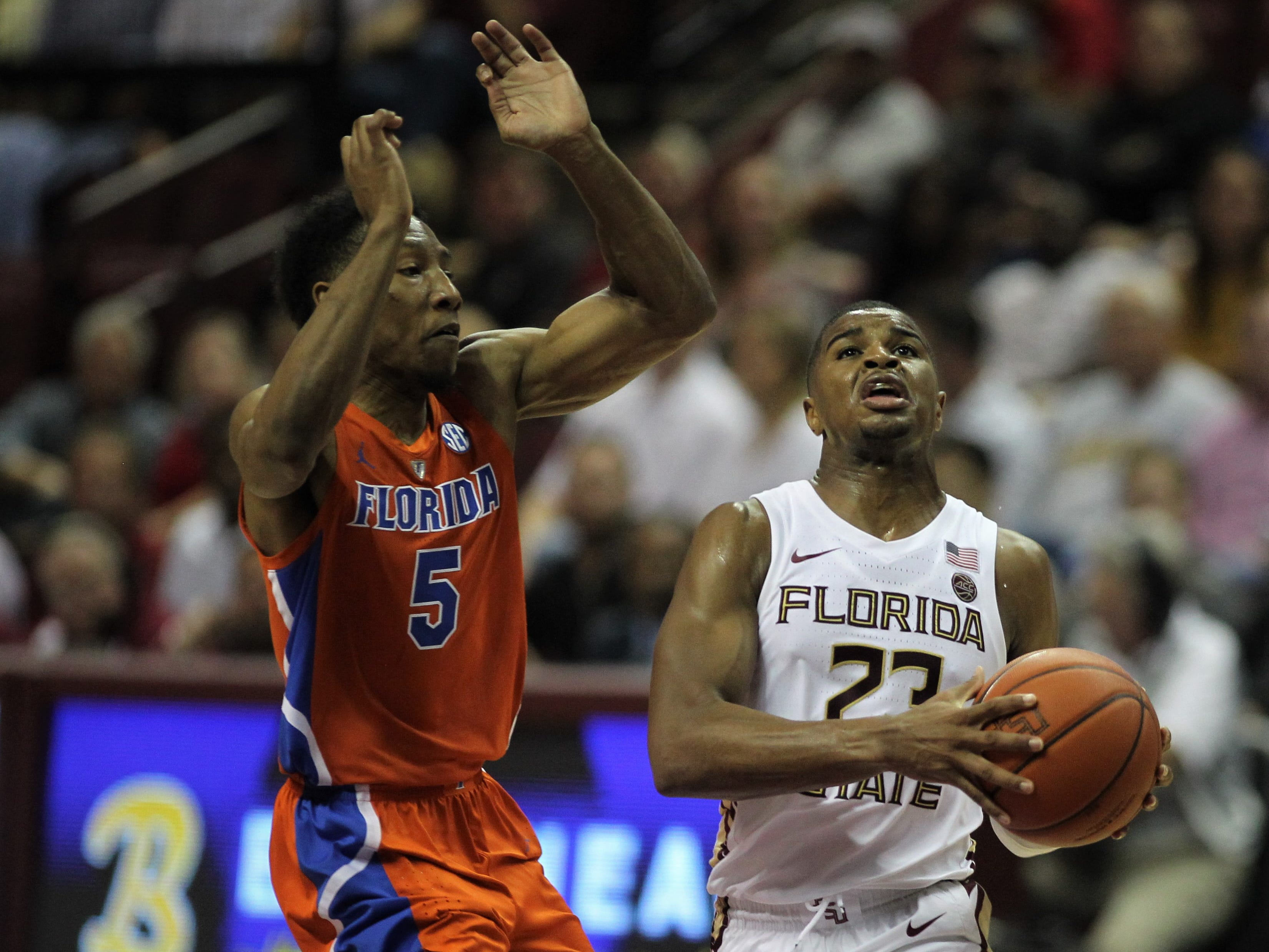 Florida State's M.J. Walker tries for a breakaway layup as Florida's Kevaughn Allen defends during the Sunshine Showdown game Tuesday at the Tucker Civic Center.