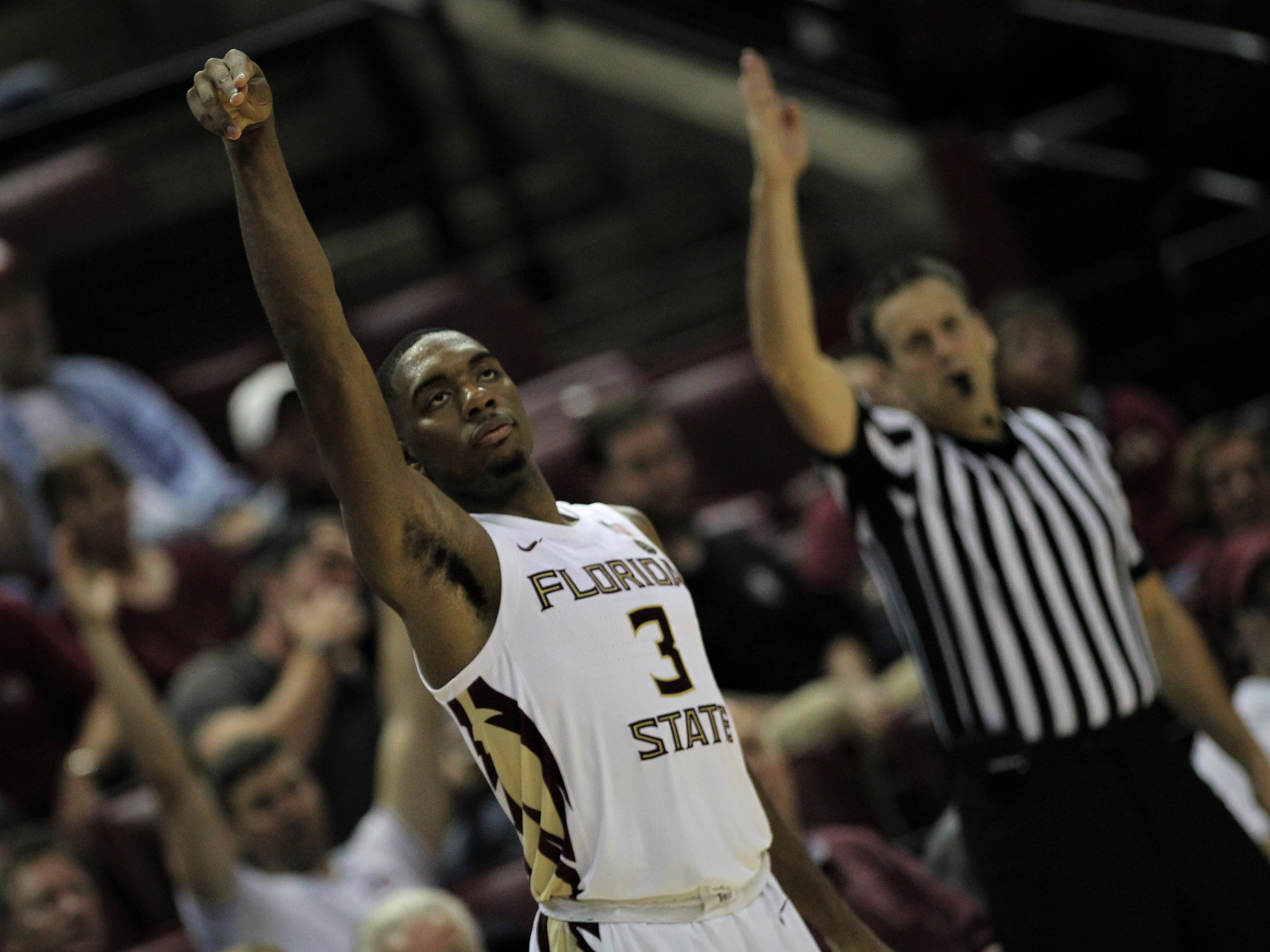 Florida State's Trent Forrest reacts to another made 3-pointer during the Sunshine Showdown game against Florida on Tuesday at the Tucker Civic Center.