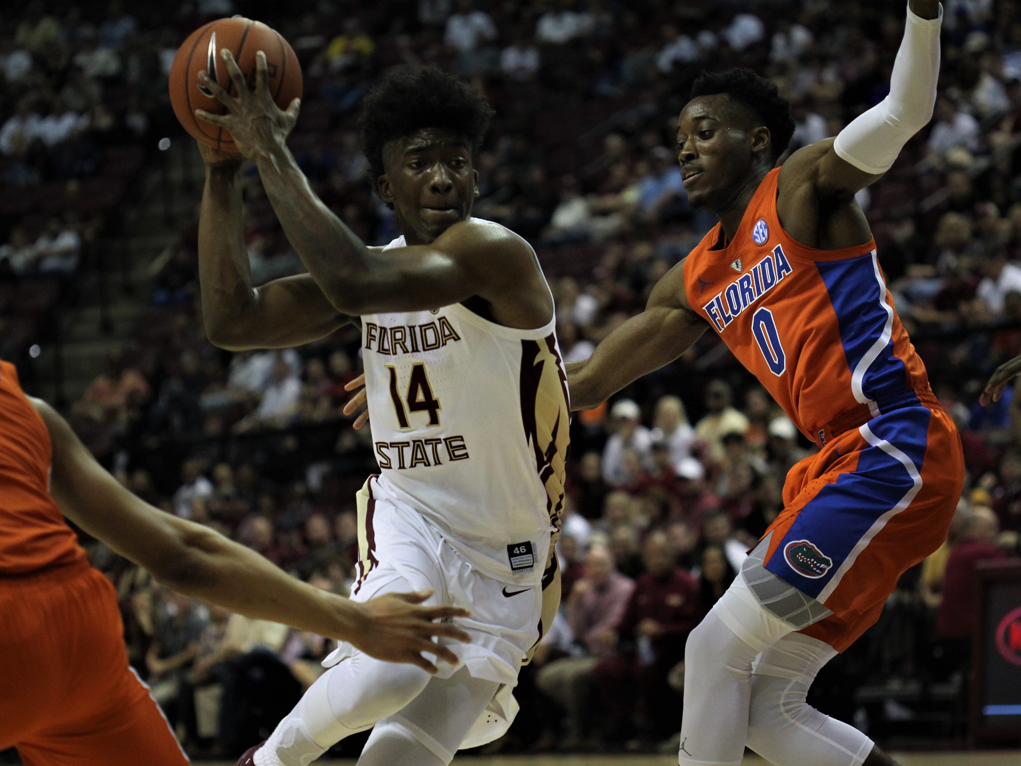 Florida State's Terance Mann drives against Florida's Mike Okauru during the Sunshine Showdown game Tuesday at the Tucker Civic Center.