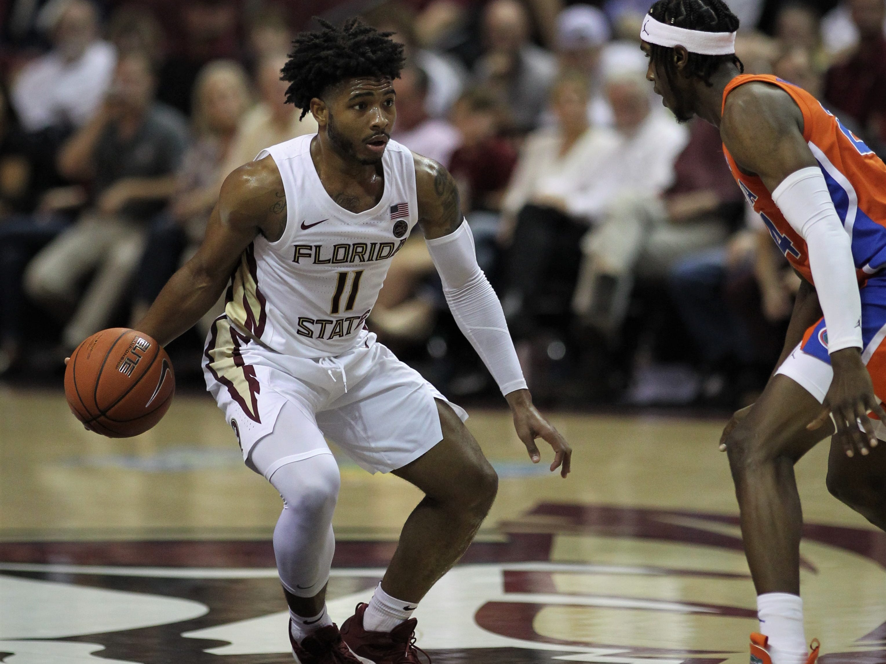 Florida State's David Nichols makes a dribble move on Florida's Daundrae Ballard during the Sunshine Showdown game Tuesday at the Tucker Civic Center.