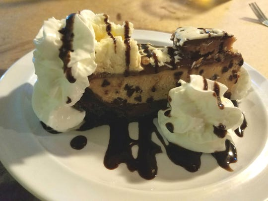 Gettin Crabby's  peanut butter pie with whipped cream, chocolate chips and a generous chocolate crust.