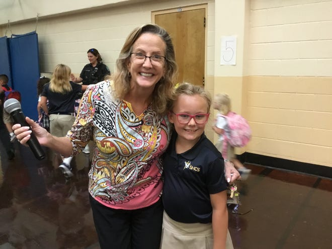 St. Helen Catholic School Principal Lisa Bell with second-grade student Bella Center.