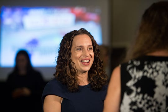 U.S. Dist. 18 Democratic candidate Lauren Baer supporters gather to watch results in her bid to unseat incumbent Republican Rep. Brian Mast at Baer's election night party at Embassy Suites Palm Beach Gardens on Tuesday, Nov. 6, 2018, in Palm Beach Gardens.