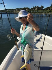 Eva Conner with a jack that she caught on the Indian River with Captain Charlie Conner.