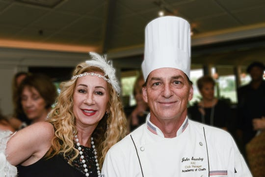 """Hibiscus Children's Center """"All That Jazz Casino Night"""" Chair Brenda Woolston and Executive Chef John Saundry.  Casino Night is Jan. 11 at Mariner Sands Country Club, Stuart. For tickets, call 772-334-9311, ext. 404, or online at HibiscusChildrensCenter.org."""
