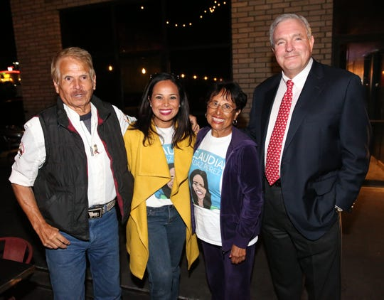 District 6 city Rep. Claudia Ordaz Perez, with her parents, Ariel and Martha Ordaz, and Mayor Dee Margo pose at her re-election night party Tuesday at Crave Kitchen & Bar at 11990 Rojas Drive.