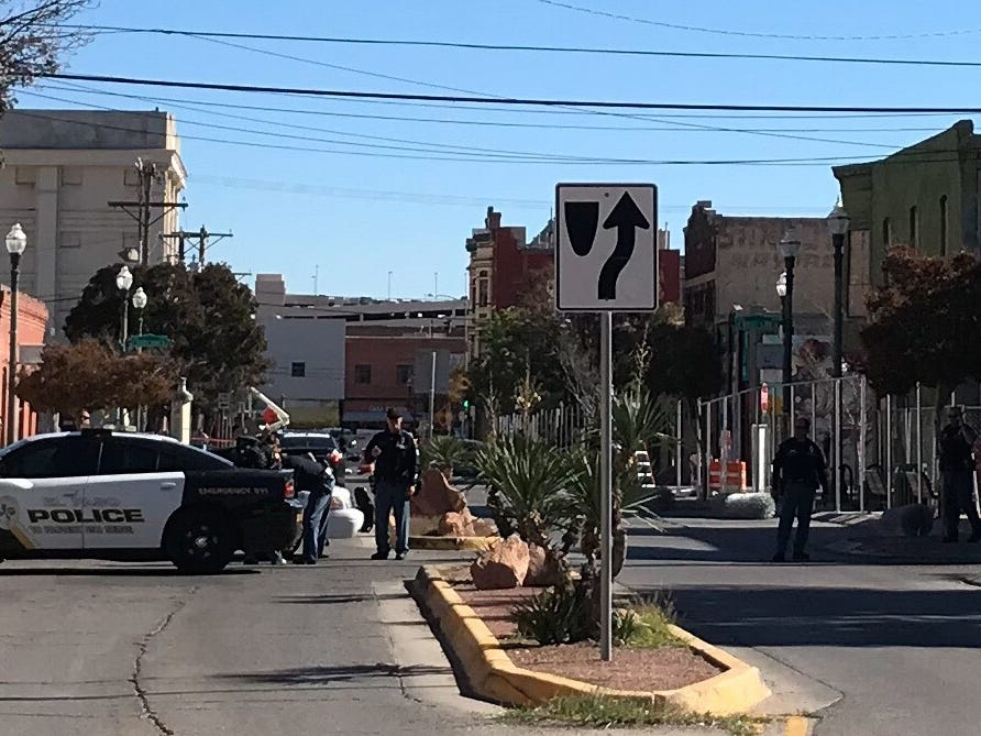 El Paso police officers Wednesday secure a site in Duranguito as a crew begins installing fencing.