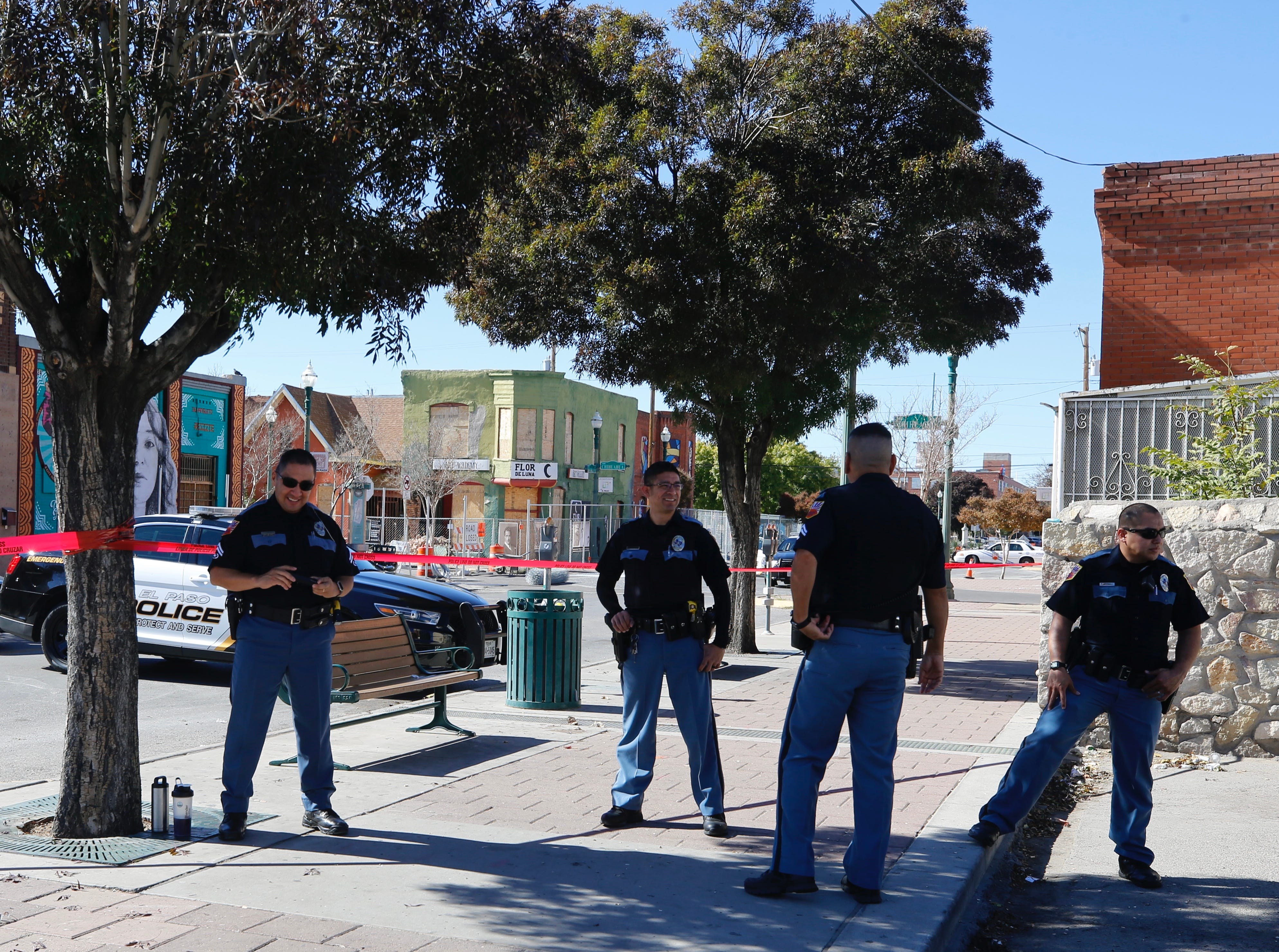 Police stand guard Wednesday as a crew installs more secure fencing around the planned future site of the multipurpose Downtown arena in Duranguito. An archaeological study will be conducted in the area.
