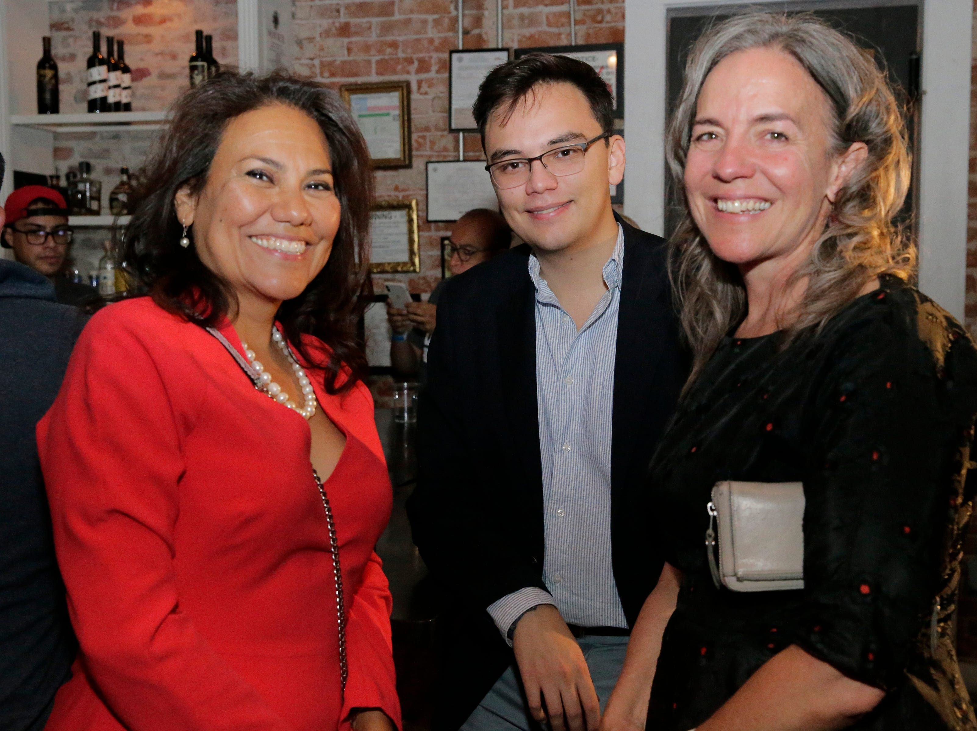 U.S. Rep.-elect Veronica Escobar celebrates her election victory with her son and campaign aide Susie Byrd at Later Later in Downtown El Paso. She will be one of the first Latinas from Texas in Congress.