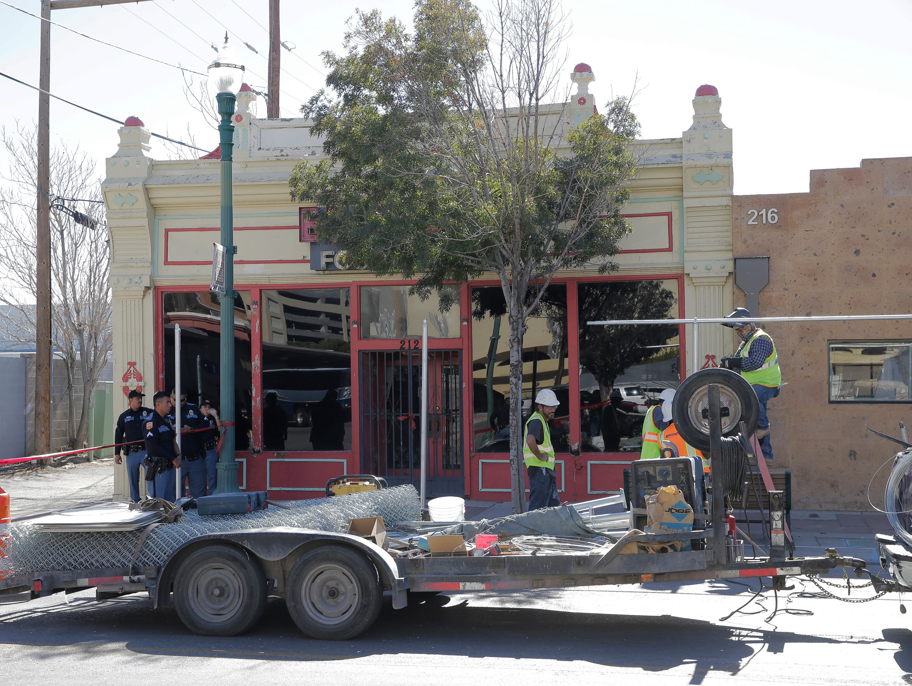 A crew Wednesday installs more secure fencing around the planned future site of the multipurpose Downtown arena in Duranguito. An archaeological study will be conducted in the area.
