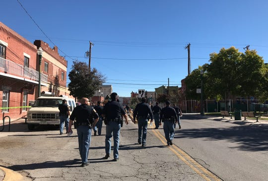 El Paso police officers arrive Wednesday morning to help secure a site in Duranguito as a crew begins installing fencing.