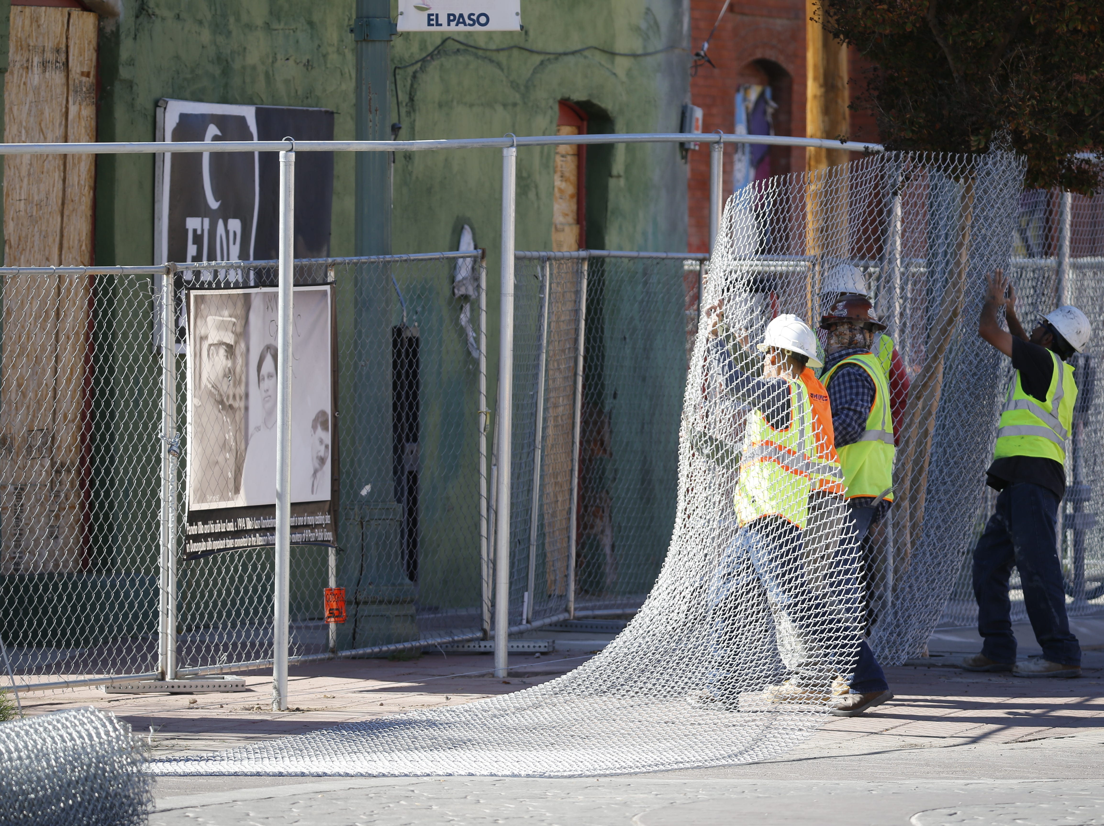 A crew on Nov. 7, 2018, installs more secure fencing around the planned future site of the multipurpose Downtown arena in Duranguito. An archaeological study will be conducted in the area.
