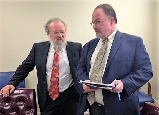 "Ronald Ingalls, left, Chapter 11 bankruptcy trustee handling William 'Billy"" Abraham's bankruptcy cases, and Stephen Sather, an Austin lawyer representing the trustee, conducted a Nov. 6 auction of 11 Abraham properties at the old federal courthouse in Downtown El Paso."